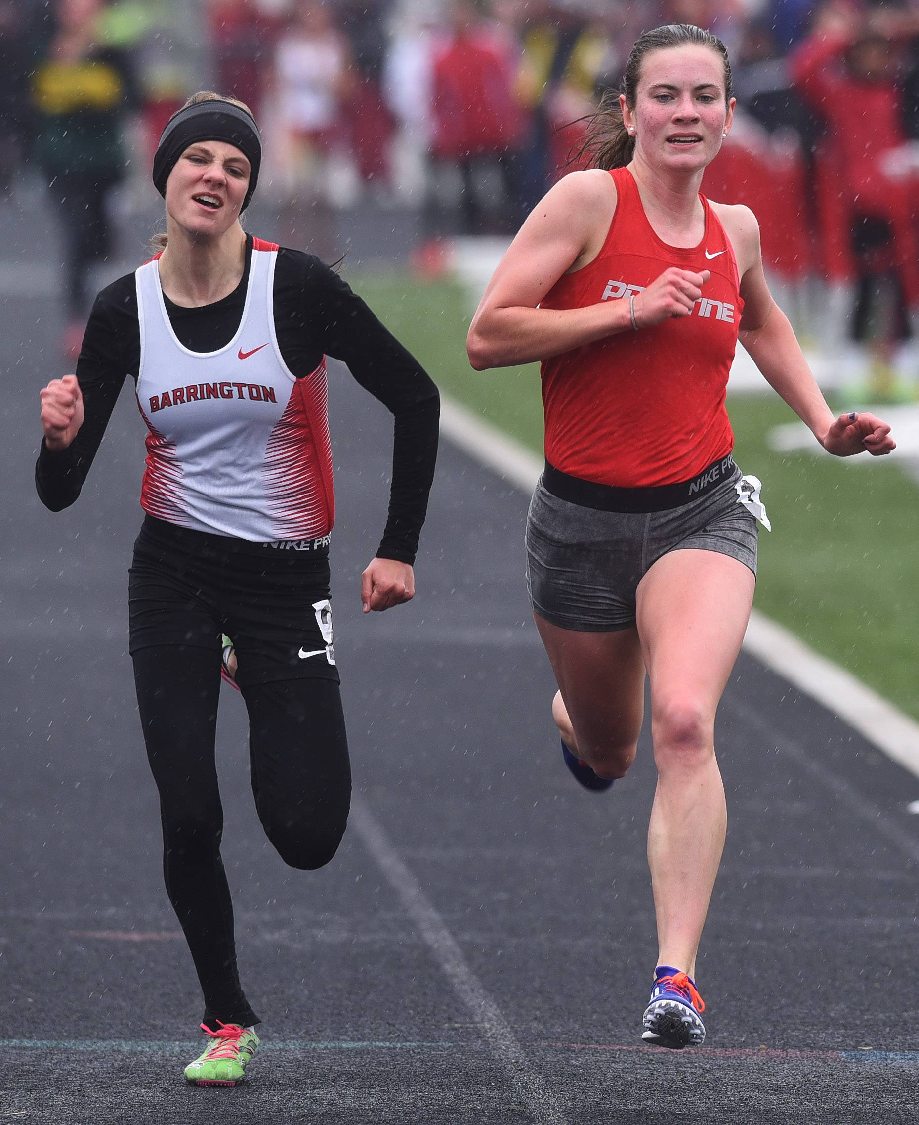 Palatine's Kelly O'Brien, right, finishes the girls 1,600-meter run ahead of Barrington's Jocelyn Long during the Palatine Relays at Palatine High School on Saturday. O'Brien's time was 5:15.04, while Long's was 5:15.07.