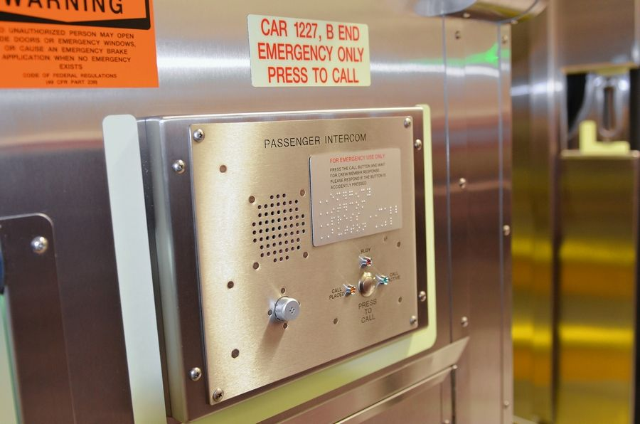 Metra is gradually installing intercoms near train car vestibules that allow passengers to talk to conductors.