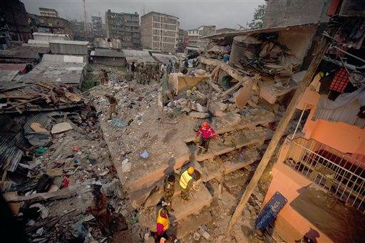 Rescuers work at the site of a building collapse in Nairobi, Kenya, Saturday, April 30, 2016. A six-story residential building in a low income area of the Kenyan capital collapsed Friday under heavy rain and flooding, trapping an unknown number of people in the rubble, Kenyan officials said.(AP Photo/Sayyid Abdul Azim)