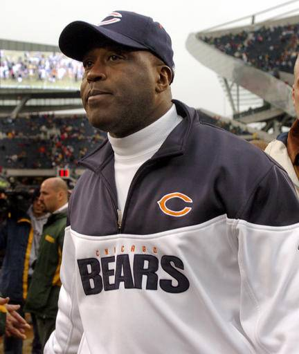 In this Jan. 2, 2005 file photo, Chicago Bears' head coach Lovie Smith walks off the field following the final NFL game of his first season in Chicago, against the Green Bay Packers. When he took over the Chicago Bears and again this spring when Illinois hired him, Lovie Smith broke new ground that came with his title. In each cases he was the team's first black head coach.