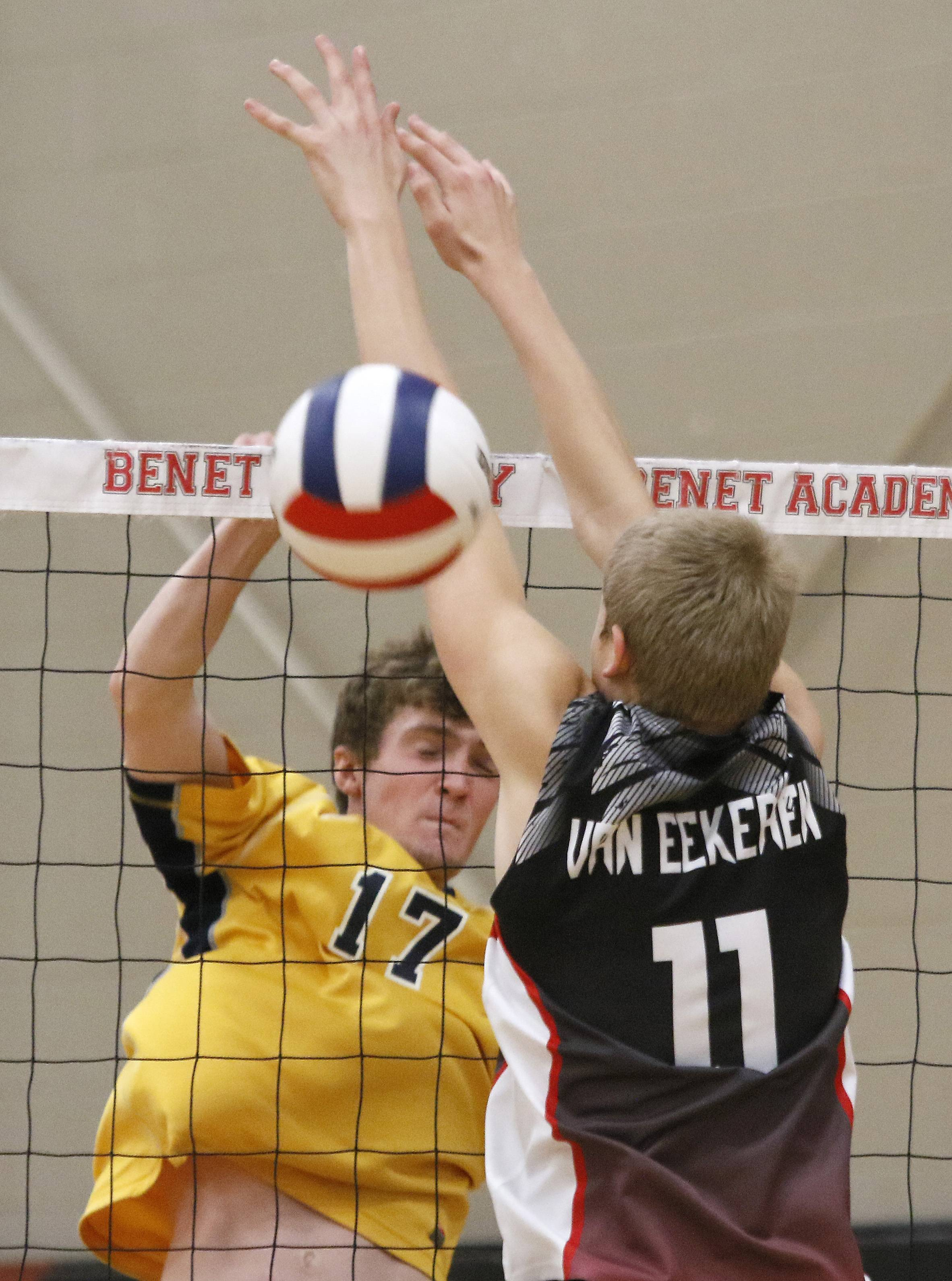 Neuqua Valley's Karl Deichmann (17) battles at the net against Benet Academy's Jackson Van Eekeren during the 11th annual Benet Academy Boys' Volleyball Invitational.