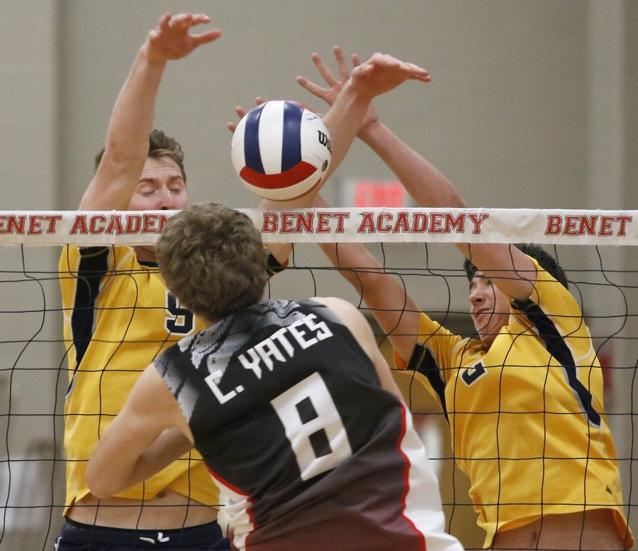 Neuqua Valley's Gregory Hedrick (9) and Aaron McKinley, right defend the net against Benet Academy's Christopher Yates during the 11th annual Benet Academy Boys' Volleyball Invitational.