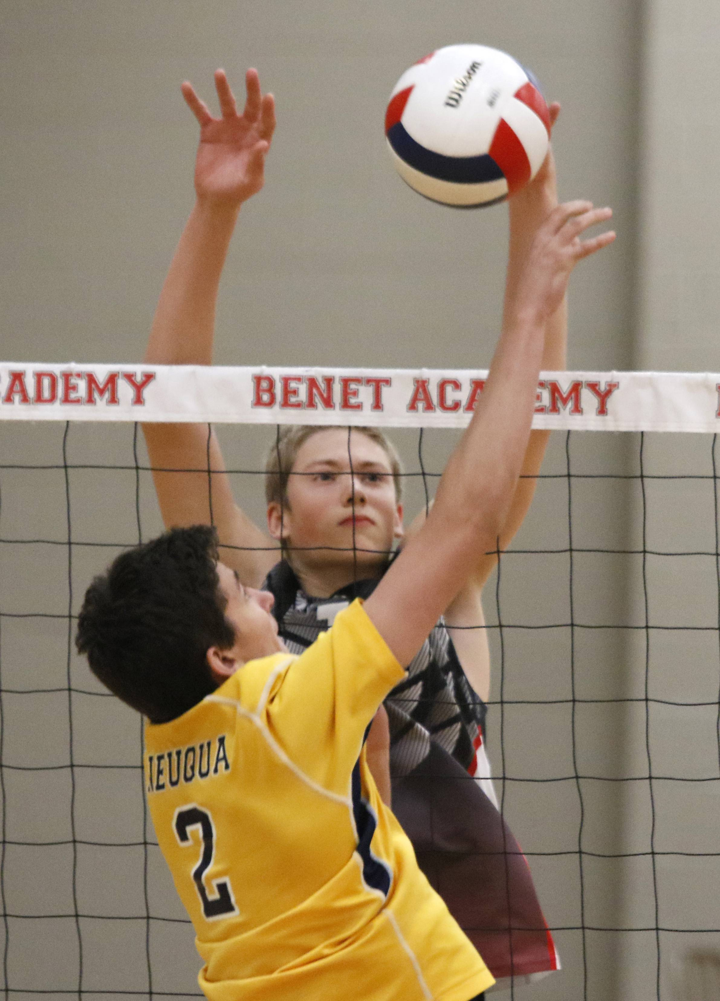 Neuqua Valley's Aaron McKinley (2) battles at the net against Benet Academy's Jackson Van Eekeren during the 11th annual Benet Academy Boys' Volleyball Invitational.