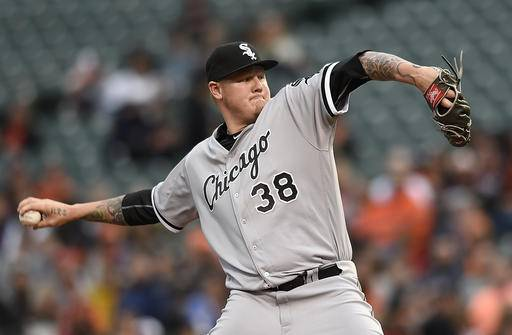Chicago White Sox pitcher Mat Latos delivers against the Baltimore Orioles in the first inning of a baseball game, Saturday, April 30, 2016, in Baltimore. (AP Photo/Gail Burton)