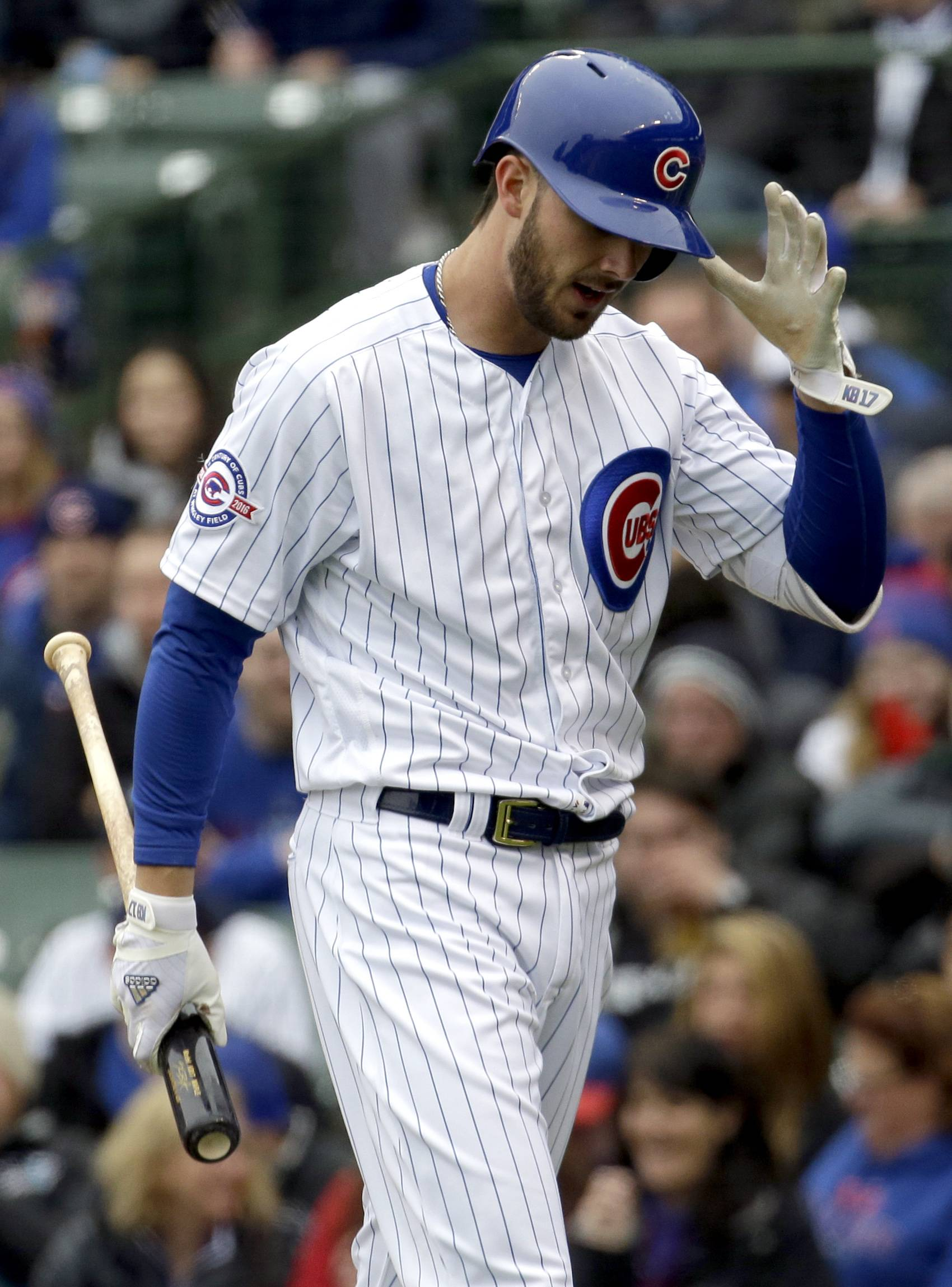 Chicago Cubs' Kris Bryant reacts after striking out during the first inning against the Atlanta Braves Sunday in Chicago. It was Bryant's first game back after spraining his ankle last Thursday against the Brewers.