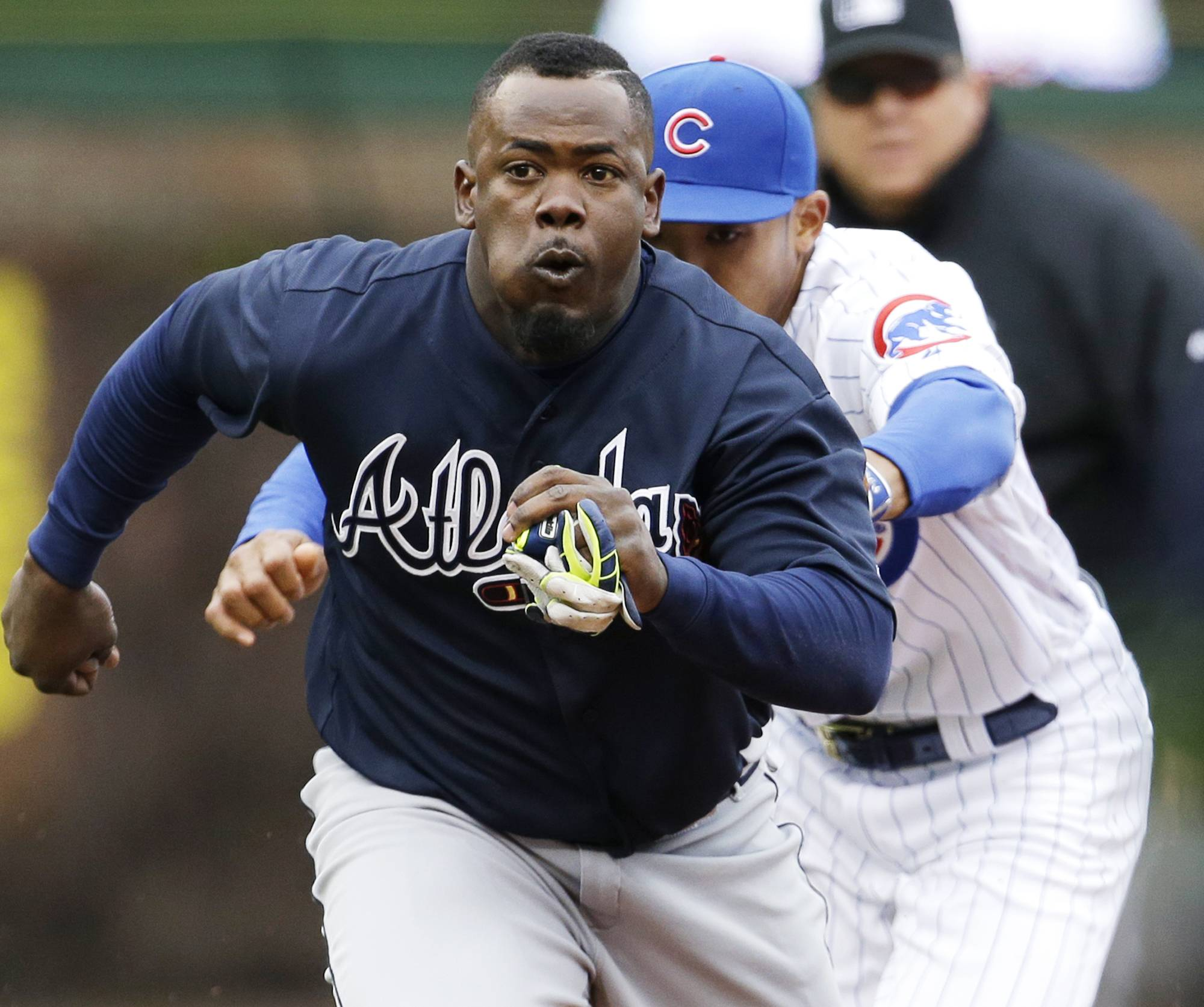 Atlanta Braves' Adonis Garcia is tagged out by Chicago Cubs shortstop Addison Russell during the sixth inning of a baseball game Sunday, May 1, 2016, in Chicago.