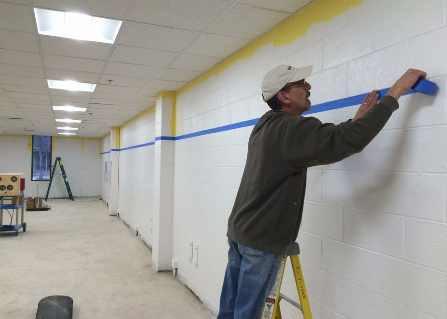 Rob DuPont, with the Mundelein District 75 Foundation, is one of the volunteers converting a former storage area at the district headquarters to a unique learning center.