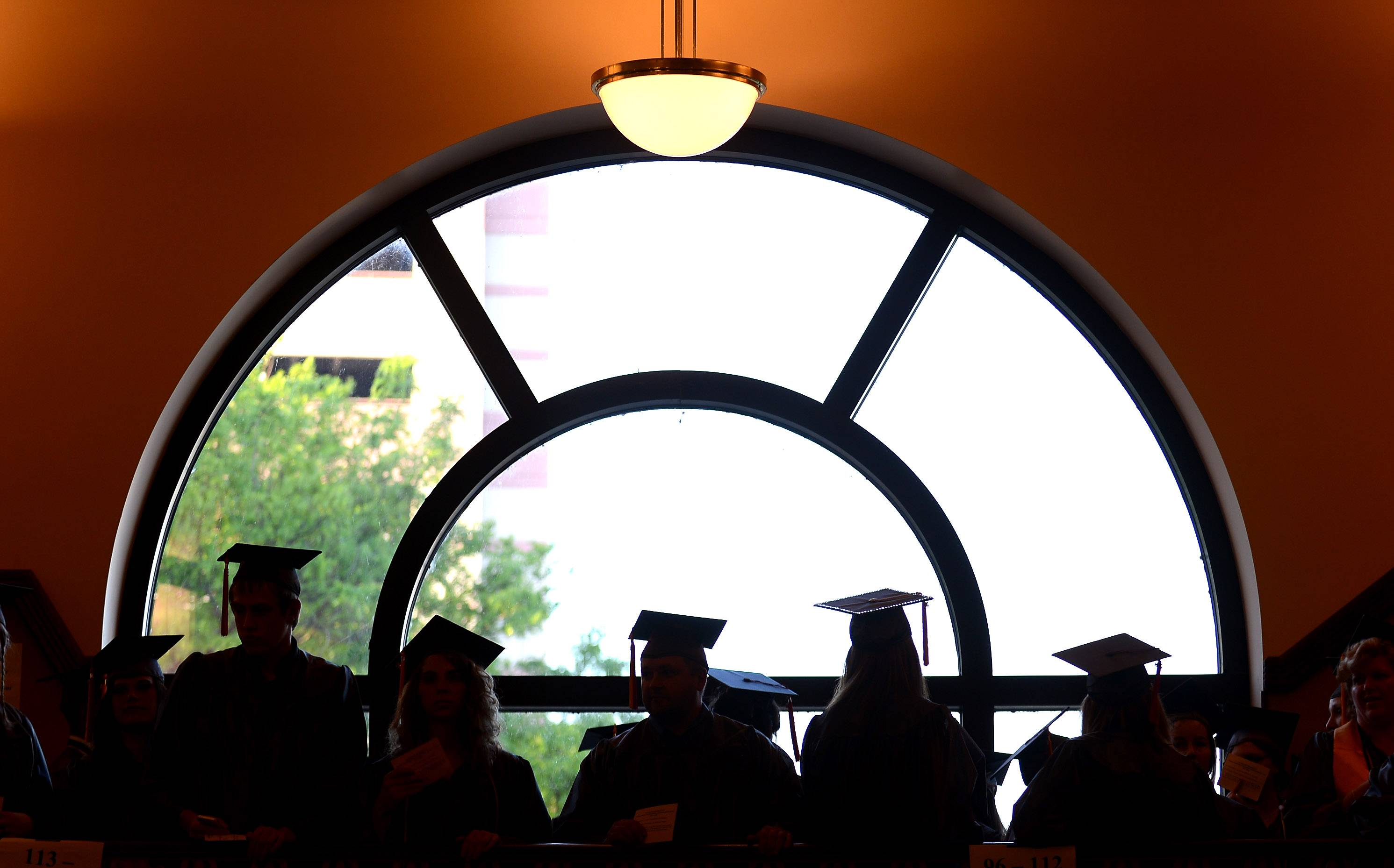 Students wait in line as they begin the processional for Waubonsee Community College's graduation ceremony at the Paramount Theater in Aurora in May 2014. The graduation ceremony is returning to the main campus in Sugar Grove.