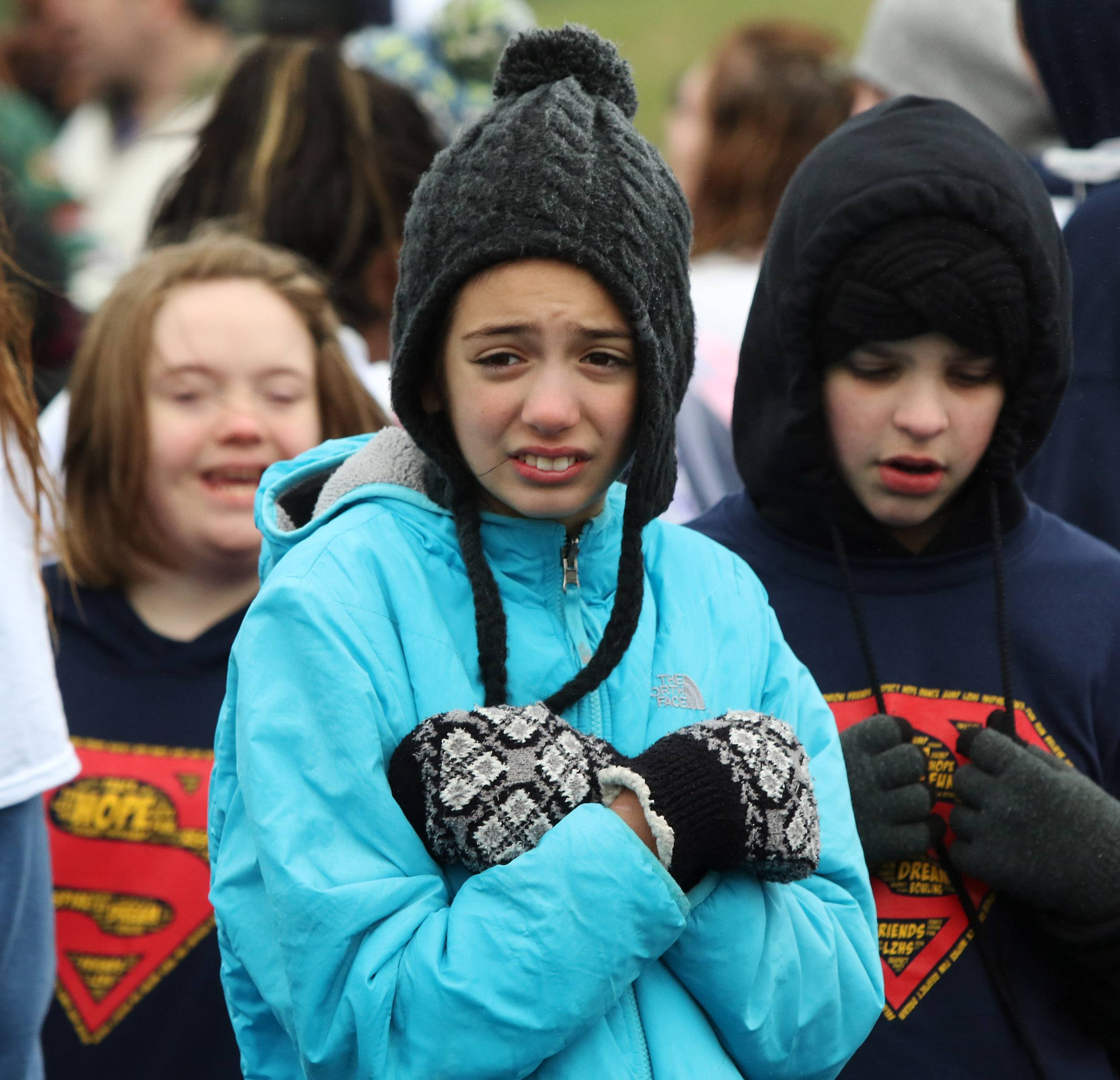Megan Hendricks, 12, of the Barrington Broncos tries to stay warm before racing during the annual Spring Games of Special Olympics Illinois Northeastern/Area 13 on Sunday at Lake Zurich High School. As a light drizzle fell on the field, Special Olympics athletes competed in races on the wet track.
