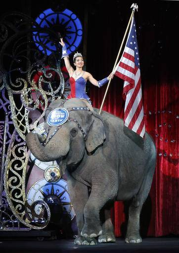 An Asian elephant performs during the national anthem for the final elephant performance during the Ringling Bros. and Barnum & Bailey Circus, Sunday, May 1, in Providence, R.I.