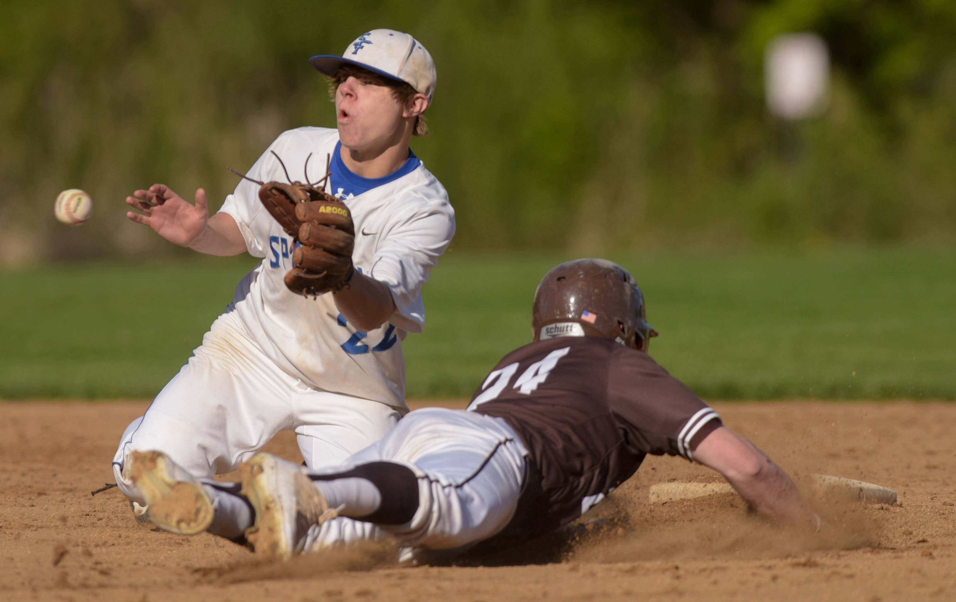 St. Francis' Zach Crescenzo comes up short with the tag on Mt. Carmel's Neil Novosel during varsity baseball in Wheaton Monday.