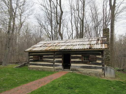This April 22, 2016 photo shows a replica of a log cabin where President James Garfield was born in Moreland Hills, Ohio. He was the last president born in a log cabin. (AP Photo/Beth J. Harpaz)