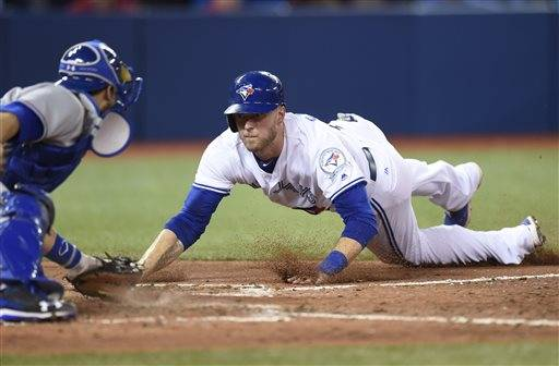Toronto Blue Jays Michael Saunders, right, is tagged out at home plate by Texas Rangers catcher Brett Nicholas for an inning-ending double play during eighth inning American League baseball action in Toronto on Monday, May 2, 2016. (Frank Gunn/The Canadian Press via AP) MANDATORY CREDIT