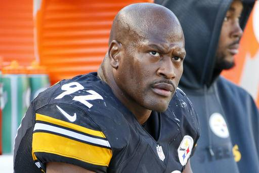 FILE - In this Nov. 8, 2015 file photo, Pittsburgh Steelers outside linebacker James Harrison (92) sits on the sidelines during an NFL football game against the Oakland Raiders, in Pittsburgh. A pair of familiar faces are heading back to Pittsburgh for the 2016 season. Veteran linebacker James Harrison announced on his Instagram page Monday, May 2, 2016, that he plans on playing this fall. And the Steelers signed backup quarterback Bruce Gradkowski to a one-year deal on Monday. (AP Photo/Gene J. Puskar, File)