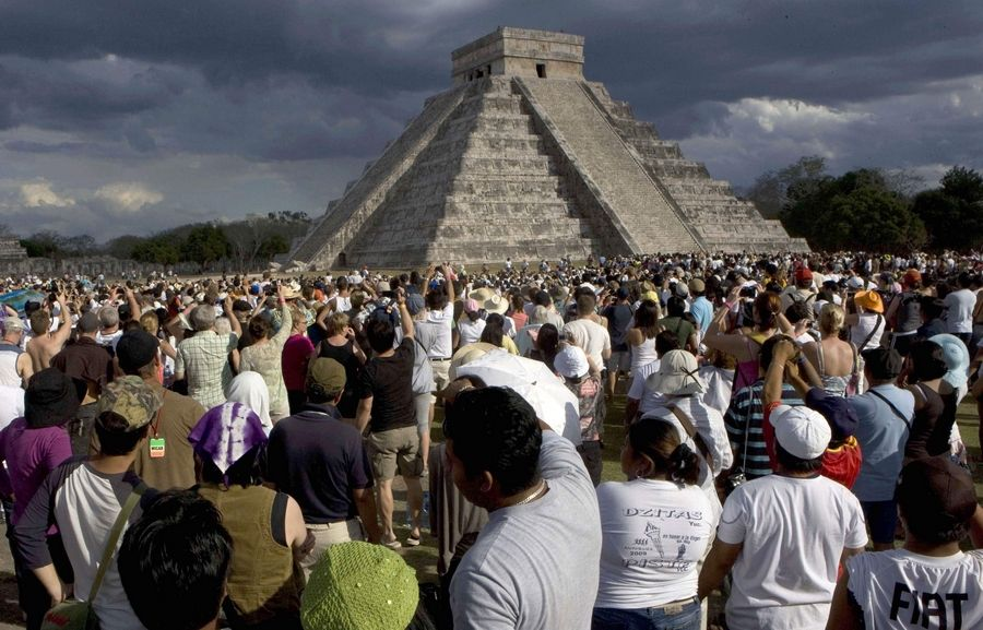 People attend the spring equinox in front of the Kukulkan Pyramid in Chichen Itza, Mexico.