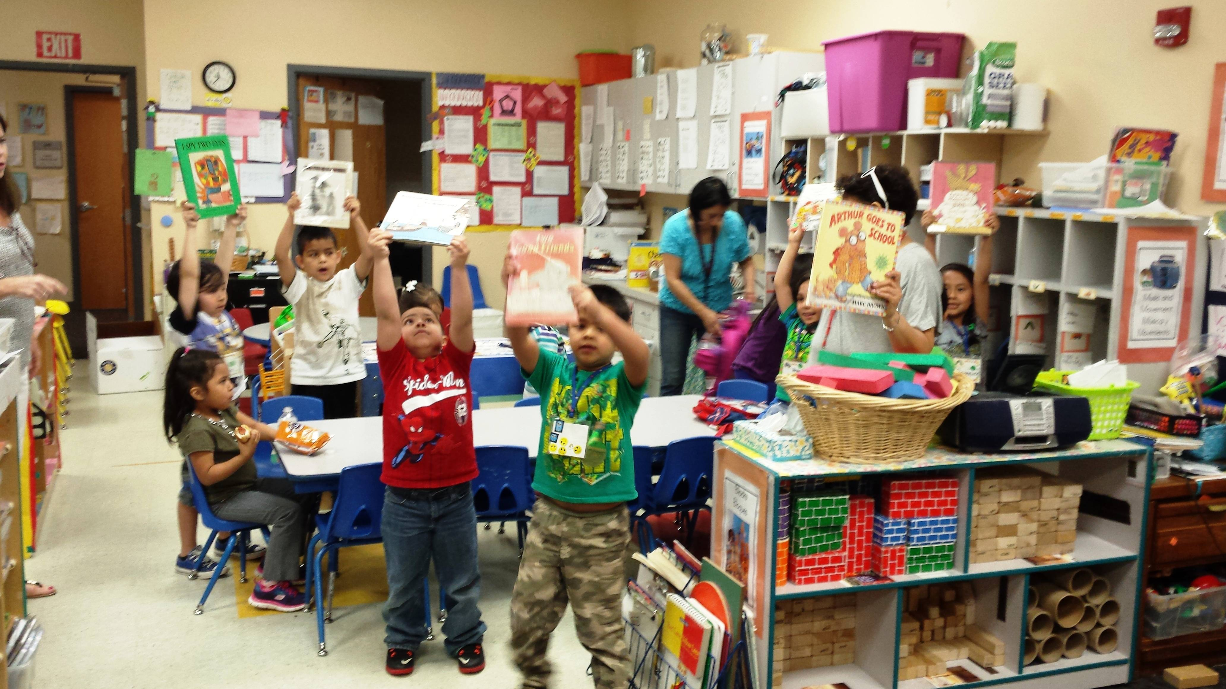 Children at the Early Childhood Development Enrichment Center in Palatine show off some of the books they received last year.
