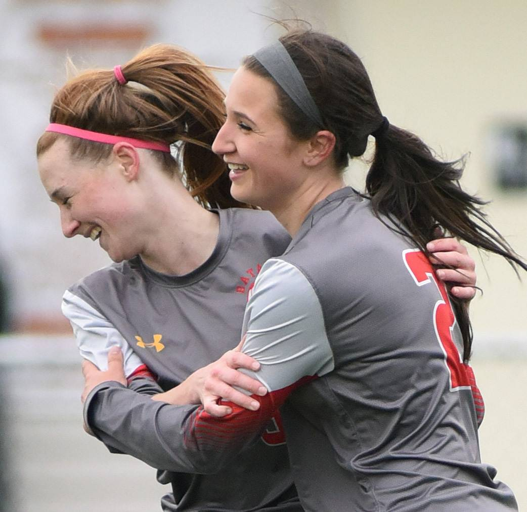 Batavia's Keegan Maris, left, and Megan McEachern celebrate a goal over Streamwood in the first half Tuesday.