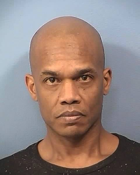 "Omar Carlton of Aurora is again accused of making ""bare foot to bare foot contact"" with a female library patron."