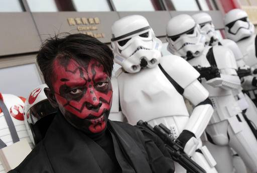 "Fans dressed as movie Star Wars characters pose as they cerebrate the Star Wars Day in Taipei, Taiwan, Wednesday, May 4, 2016. May 4 is known as Star Wars Day to fans worldwide since the date is similar to the franchise's slogan, ""May the Force Be With You."""
