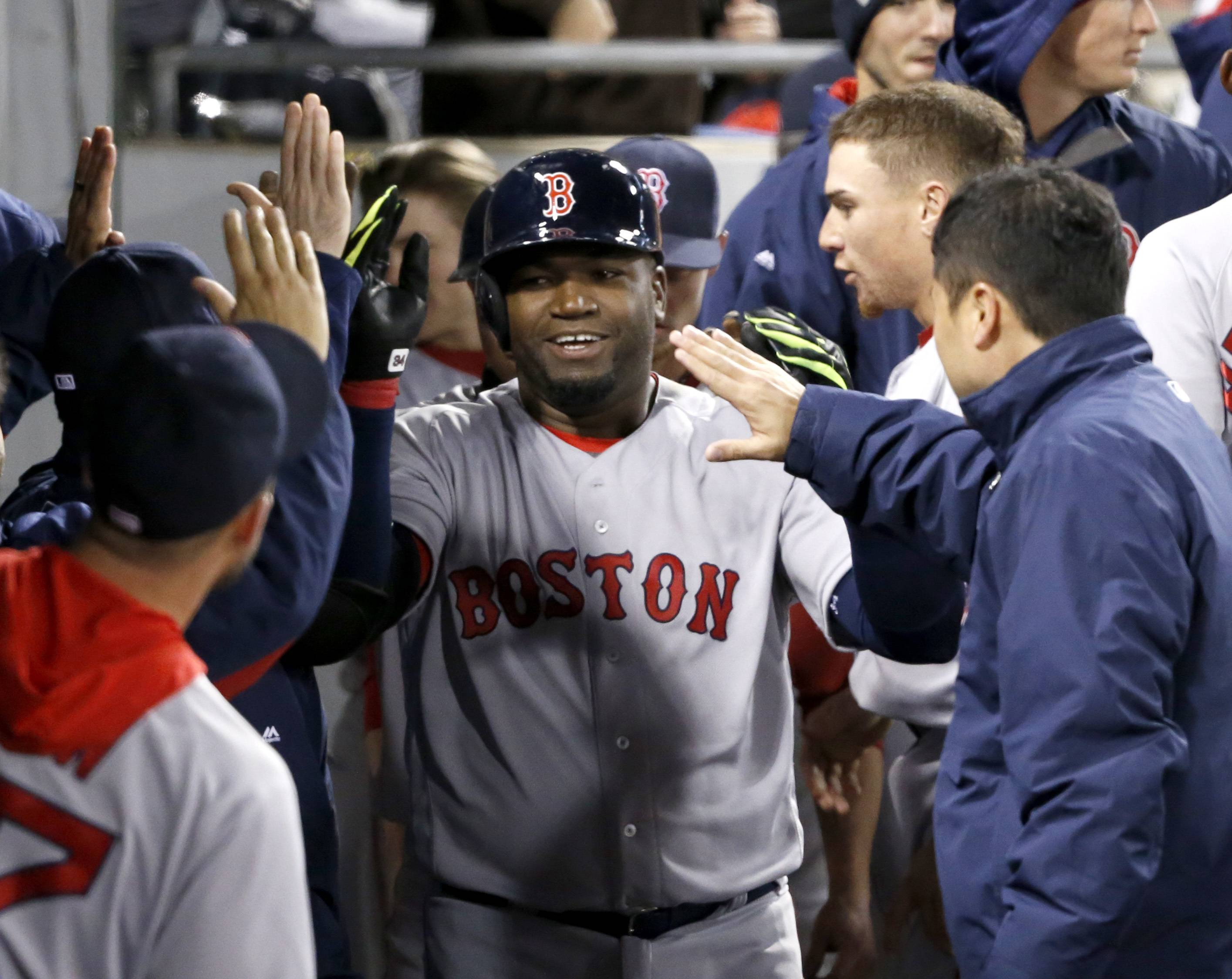Boston Red Sox's David Ortiz celebrates in the dugout his 2-run home run off Chicago White Sox starting pitcher Carlos Rodon, also scoring Xander Bogaerts, during the fifth inning of a baseball game Wednesday, May 4, 2016, in Chicago. (AP Photo/Charles Rex Arbogast)