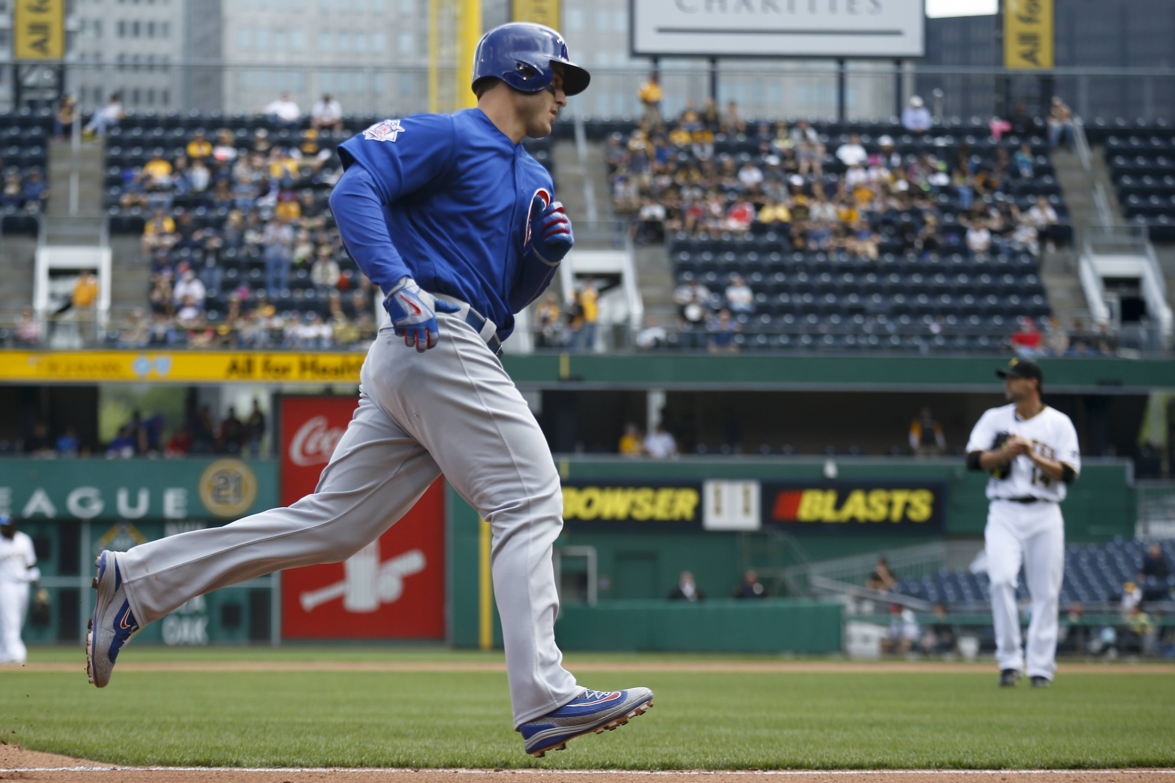 Chicago Cubs first baseman Anthony Rizzo rounds third in front of Pittsburgh Pirates relief pitcher Ryan Vogelsong after hitting a solohome run off him in the seventh inning Wednesday in Pittsburgh.
