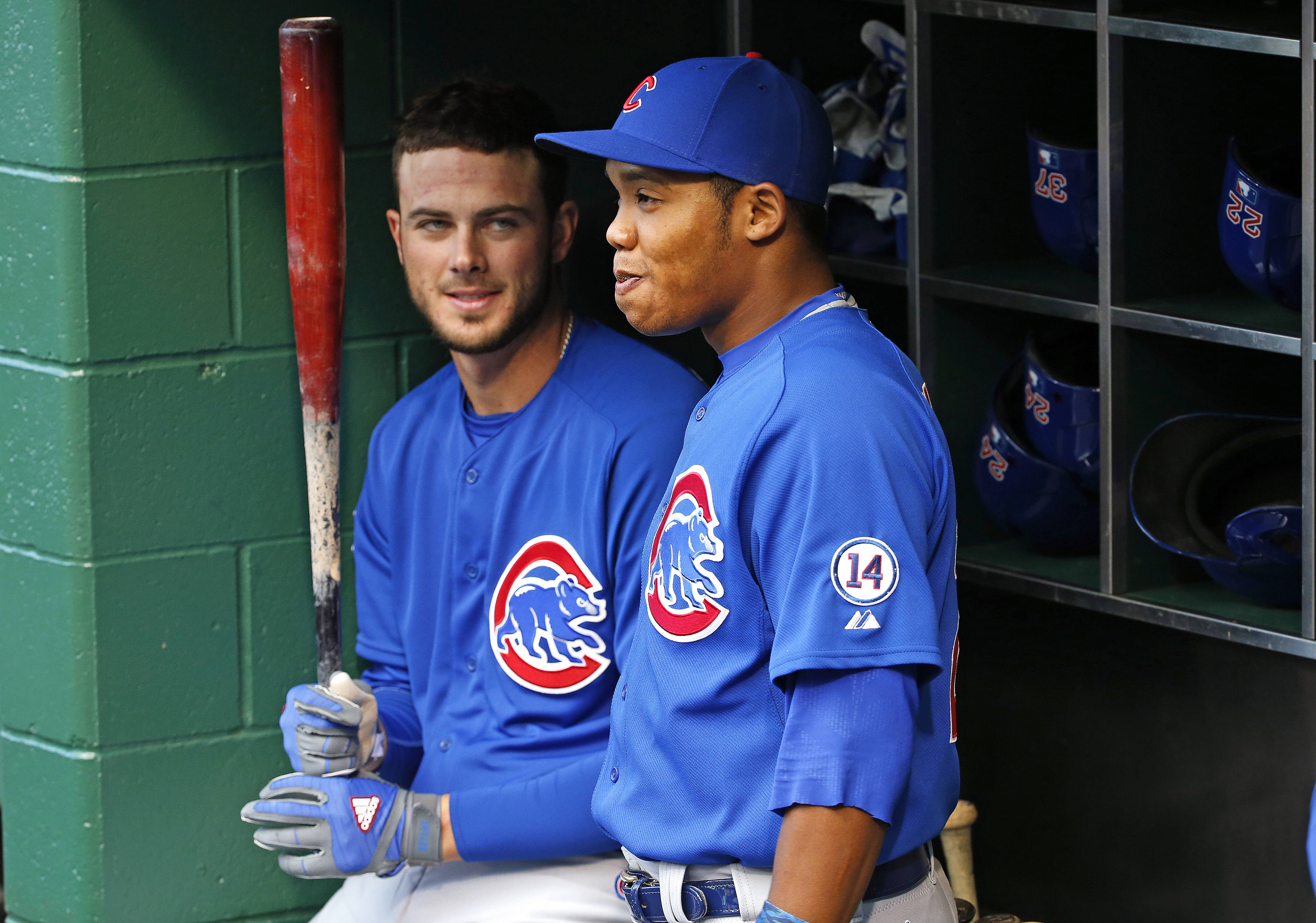 The Cubs' Addison Russell, right, now chews gum, not tobacco.