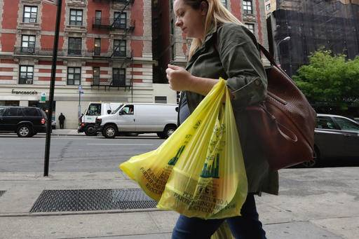 A Woman Carries Her Purchase In Plastic Bags From Gristedes Supermarket On New York S Upper