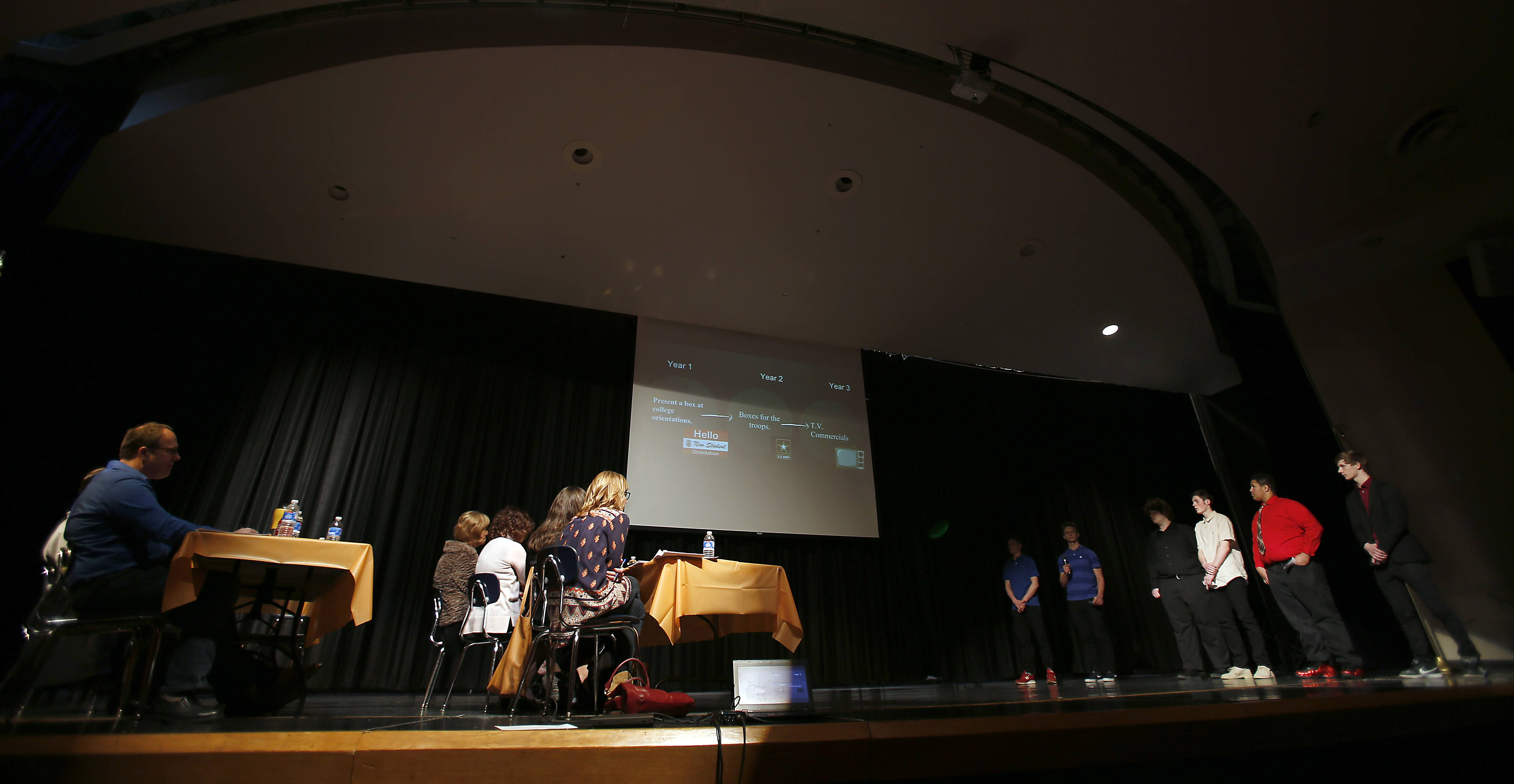 Students in the Business INCubator class at Dundee-Crown High School present their idea for a small business, MaleBox, to a group of investors Tuesday in the high school's auditorium.
