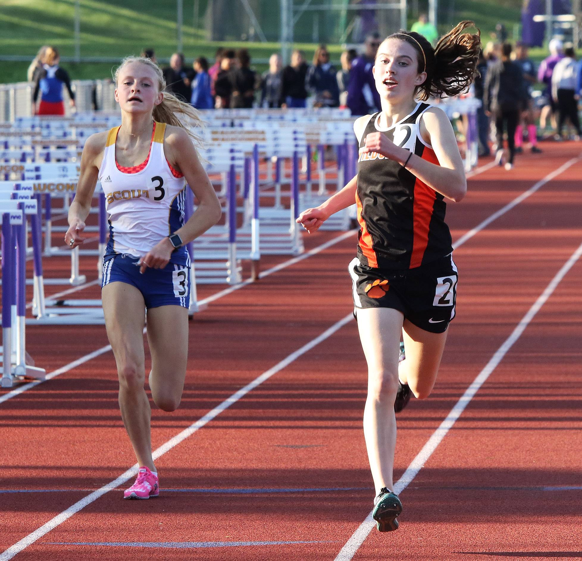 Libertyville runner Melissa Manetsch edges out Lake Forest's Brett Chody in the 3,200-meter run during the North Suburban Conference meet Thursday at Wauconda.