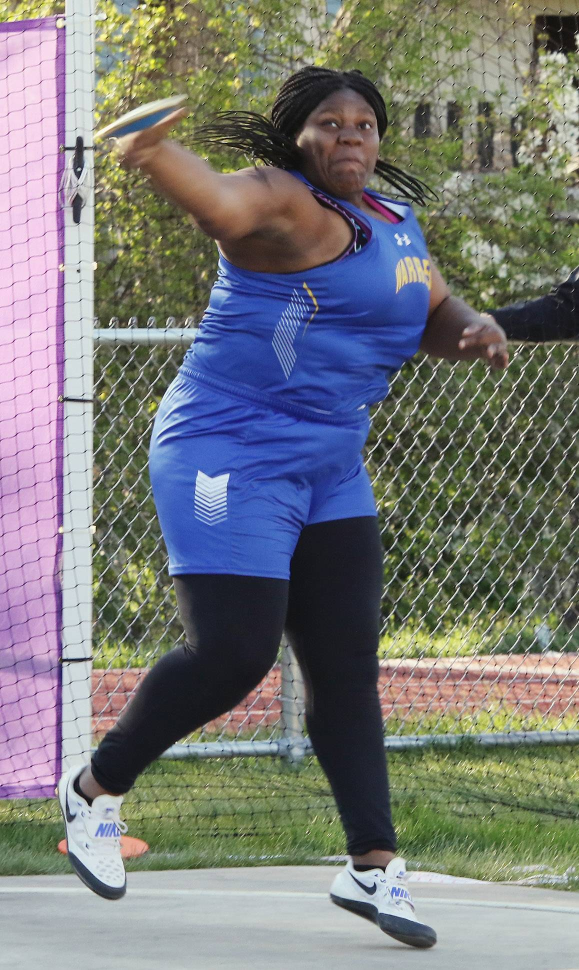 Warren's Abena Atuobi throws the discus during the North Suburban Conference meet Thursday at Wauconda.