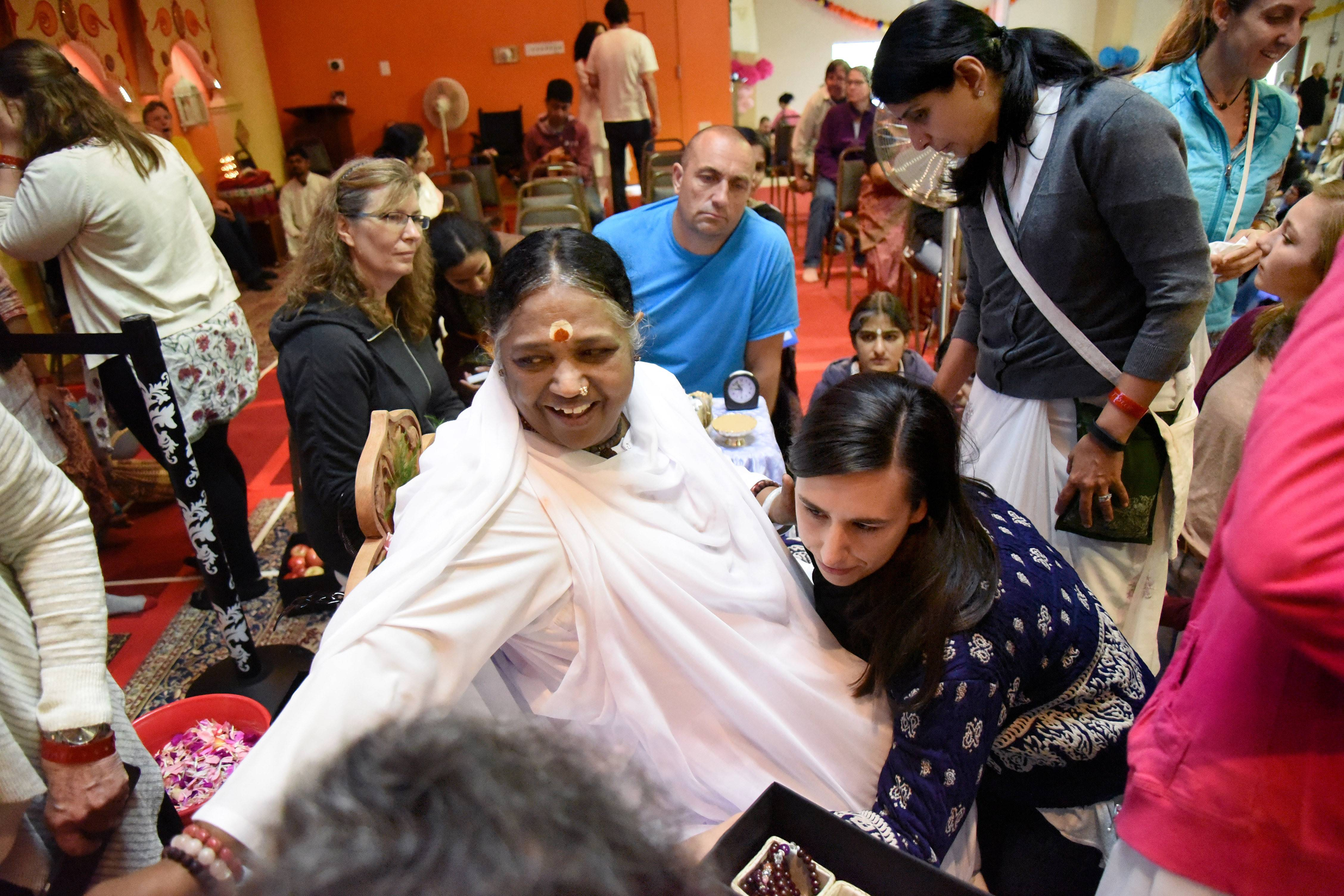 Sri Mata Amritanandamayi, a humanitarian and spiritual leader from India who blesses people with hugs, makes frequent appearances at the M.A. Center just outside of Elburn, including last year. The center has plans to enhance its 140-acre retreat with homes and apartments.