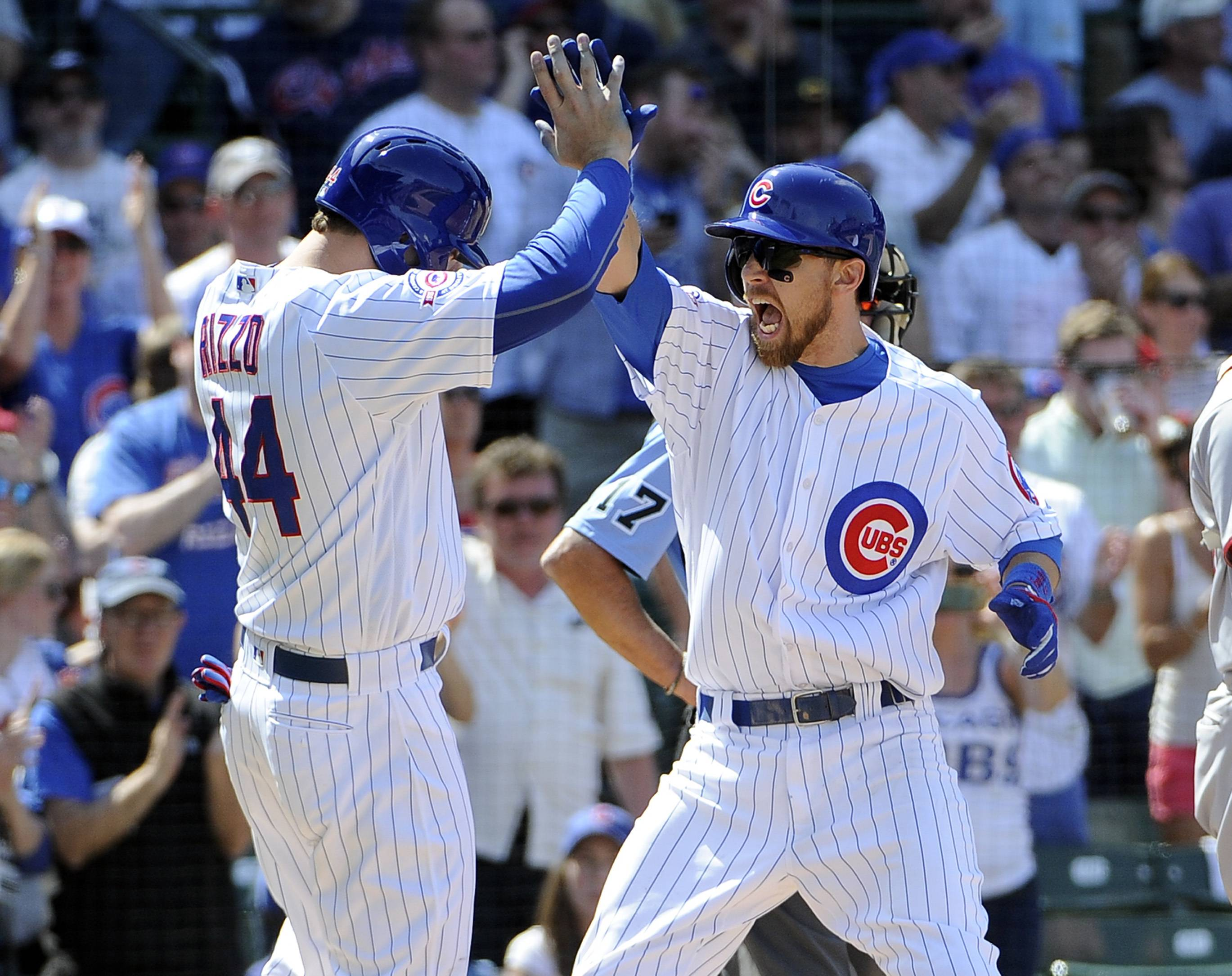 Chicago Cubs' Ben Zobrist, right, is greeted by Anthony Rizzo (44) after hitting a three-run homer against the Washington Nationals during the fifth inning at Wrigley Field on Friday.