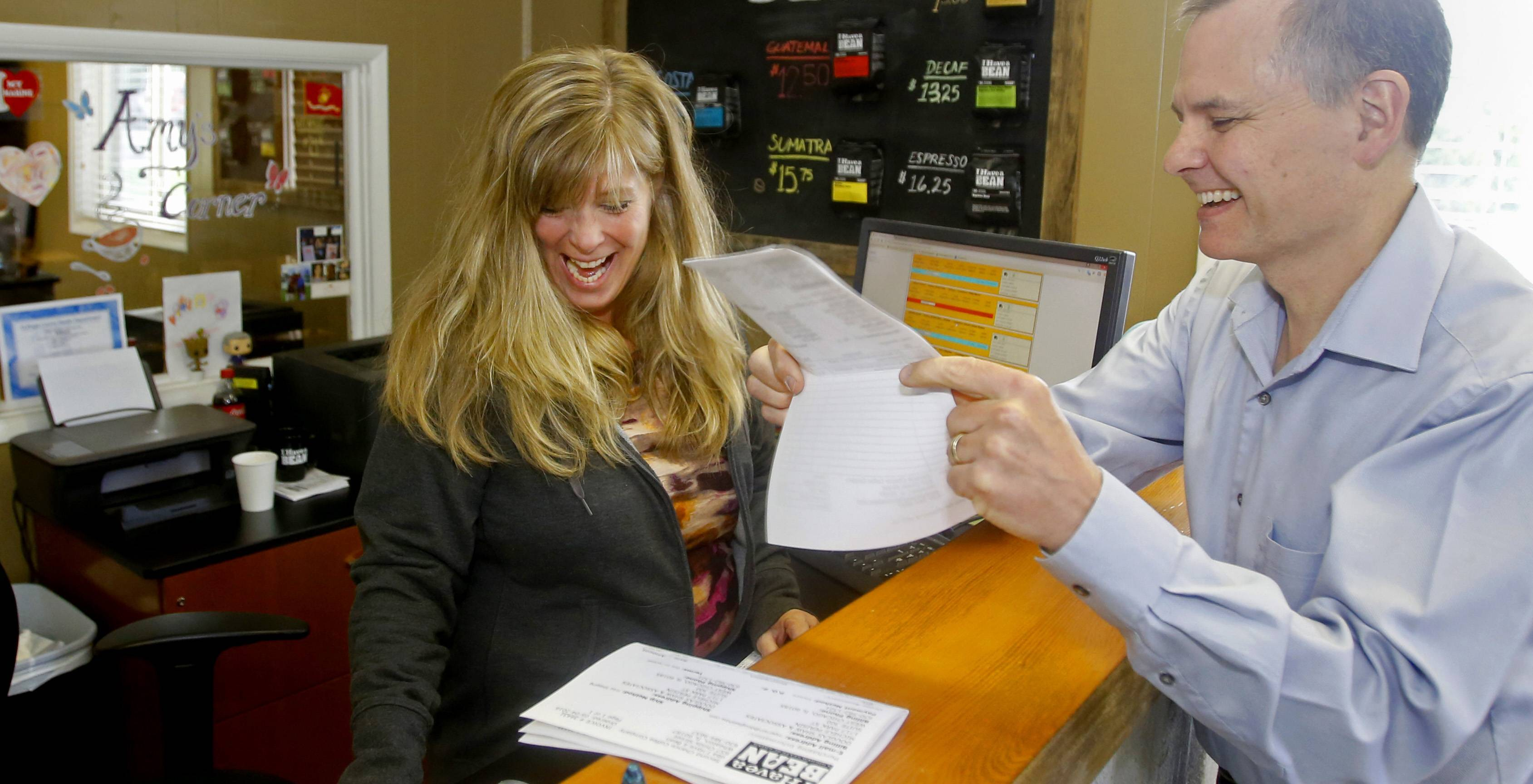 Pete Leonard, right, founder of Second Chance Coffee Company, provides employment opportunities for felons like his office manager Amy, who has been with the company for five years.