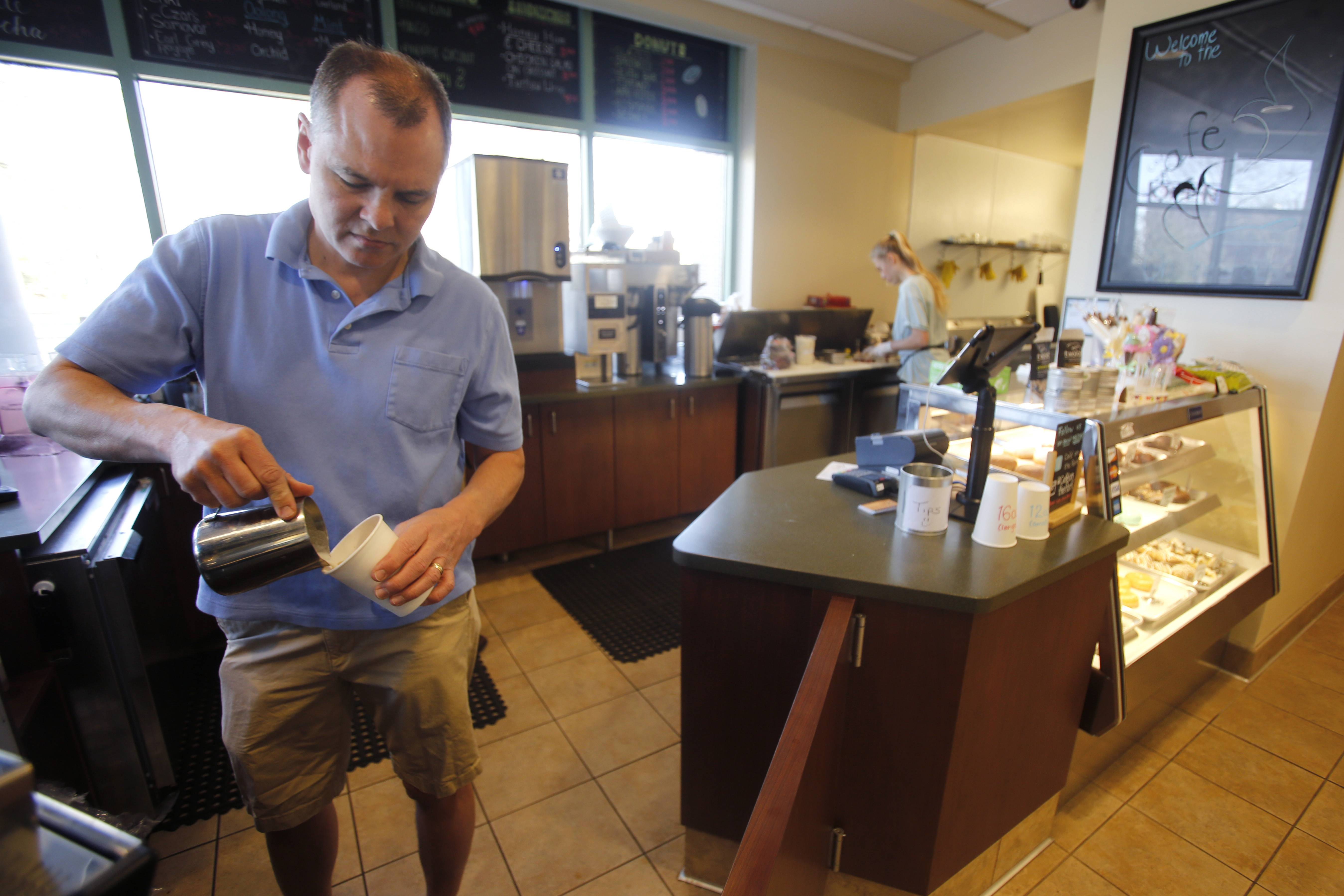 Pete Leonard makes a specialty coffee drink at Cafe on the Park, in the Wheaton Public Library.