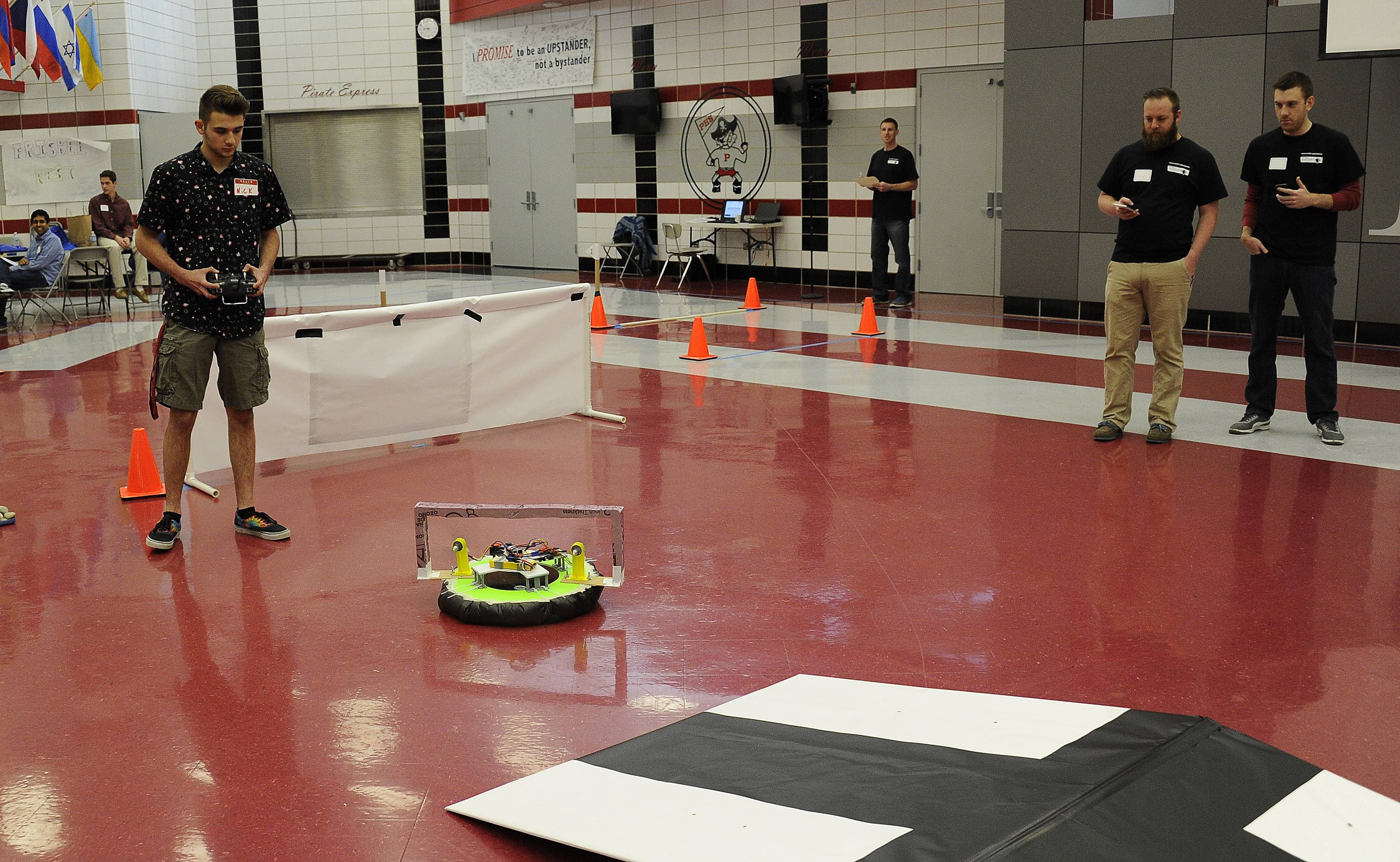 Palatine High School student Nick Losch pilots his team's hovercraft through a maze of challenges at the 2016 High School Innovation Challenge, which was sponsored by Northrop Grumman.