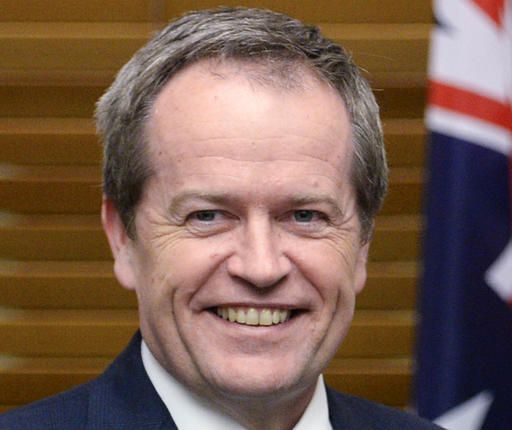 FILE - In this July 8, 2014, file photo, Australian opposition leader Bill Shorten smiles at Parliament House in Canberra. A two-month Australian election campaign is expected to officially start on Sunday, May 8, 2016 for the July 2 poll between Shorten, leader of the center-left Labor Party, and Prime Minister Malcolm Turnbull. (Lukas Coch/Pool Photo via AP, File)