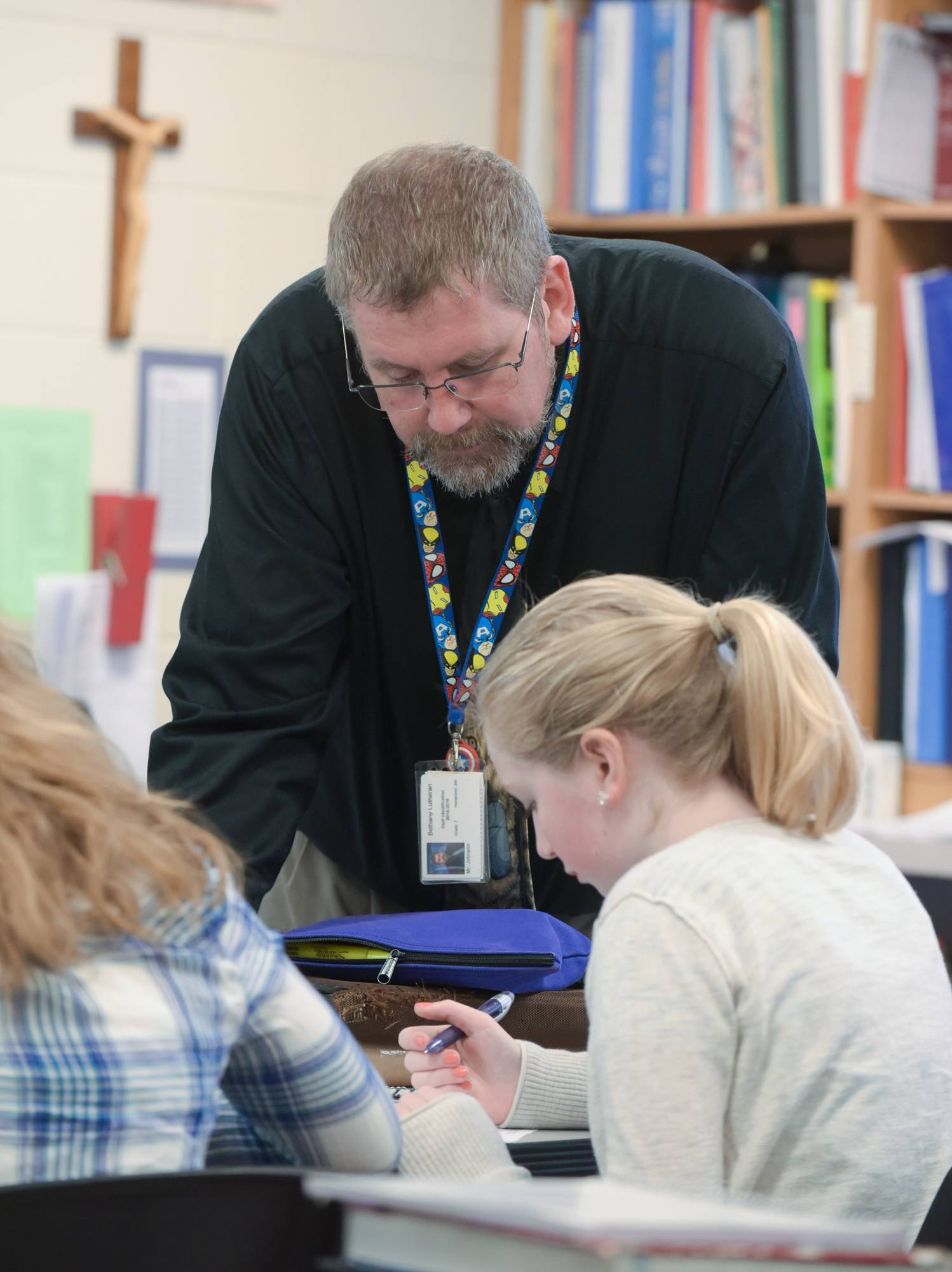 Bethany Lutheran School teacher Rob Johnson works with Brittany Johnson, who also happens to be his daughter, during an Algebra I class at the Naperville school.