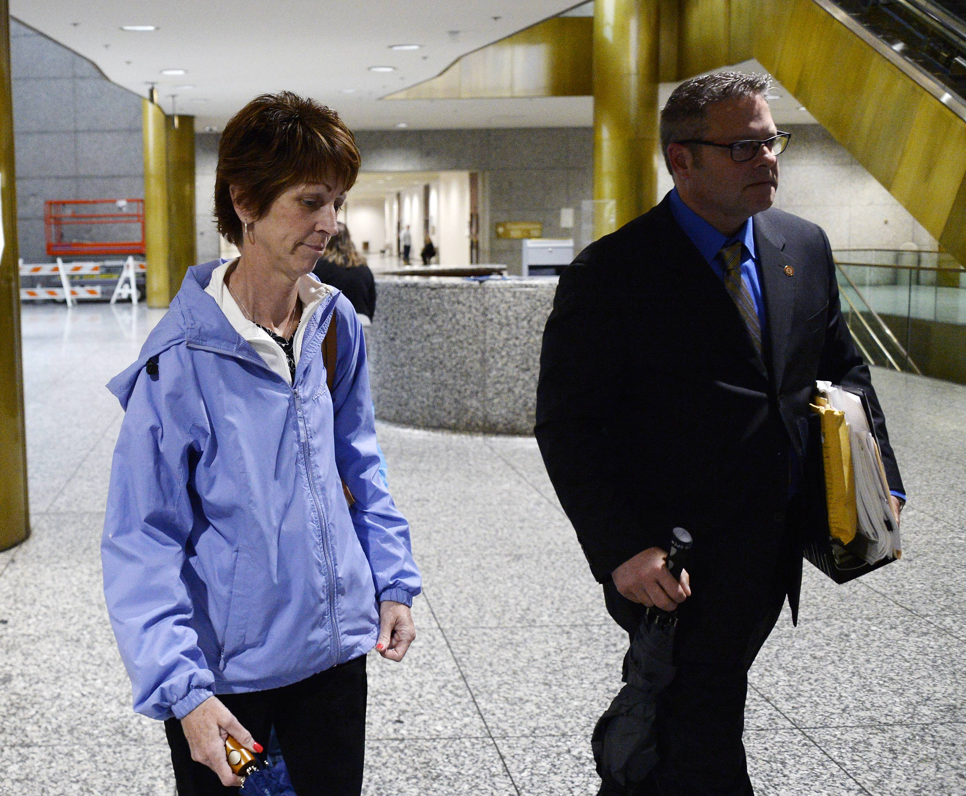 Schaumburg's Bonnie Liltz and her lawyer Thomas Glasgow leave the Rolling Meadows courthouse after Liltz pleaded guilty to involuntary manslaughter in the 2015 death of her disabled daughter, Courtney.
