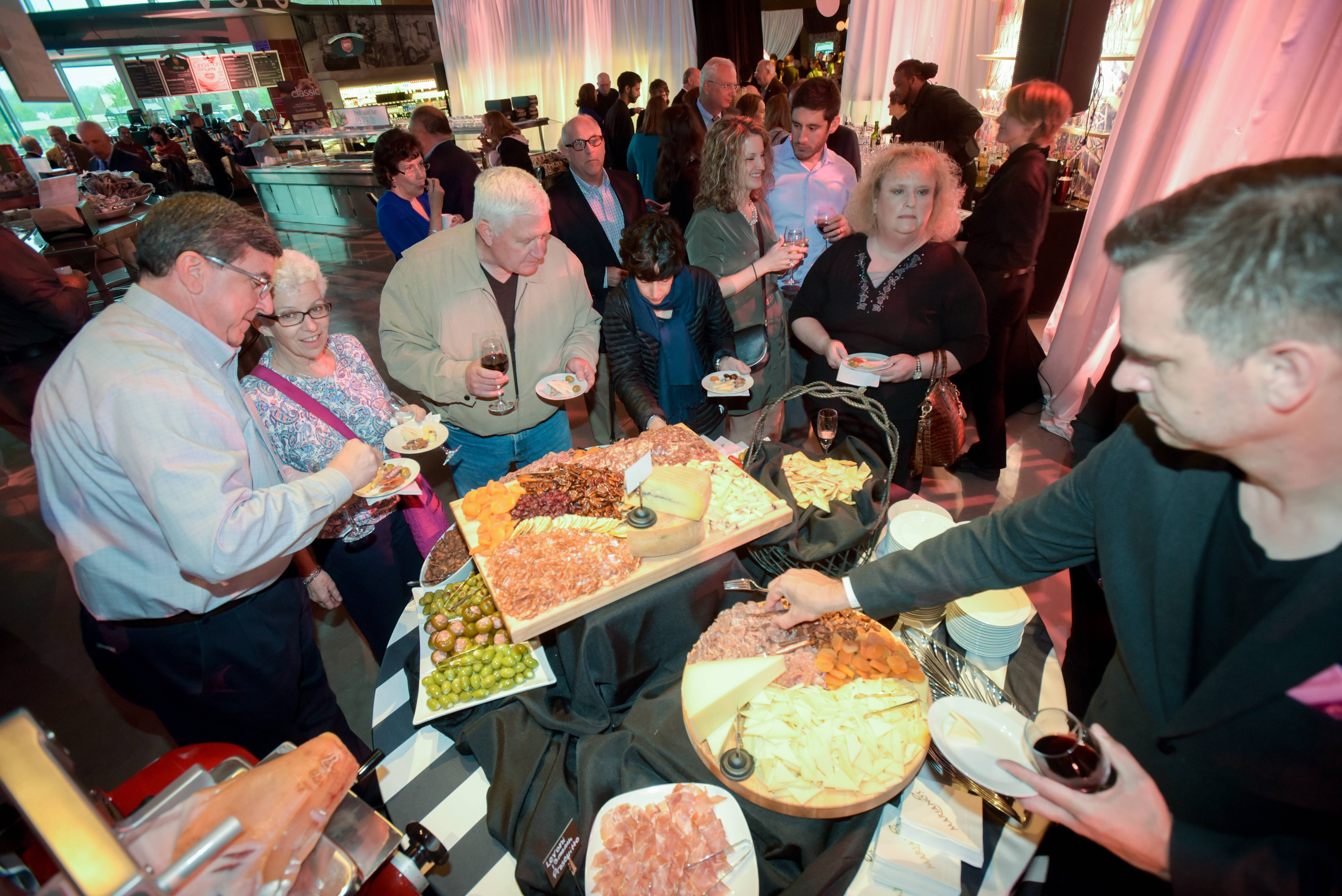 Guests at a grand opening reception Monday at a new Mariano's in Naperville sample a deli spread of meats, cheeses and olives. The store is the chain's 37th since it launched in 2010 in Arlington Heights.