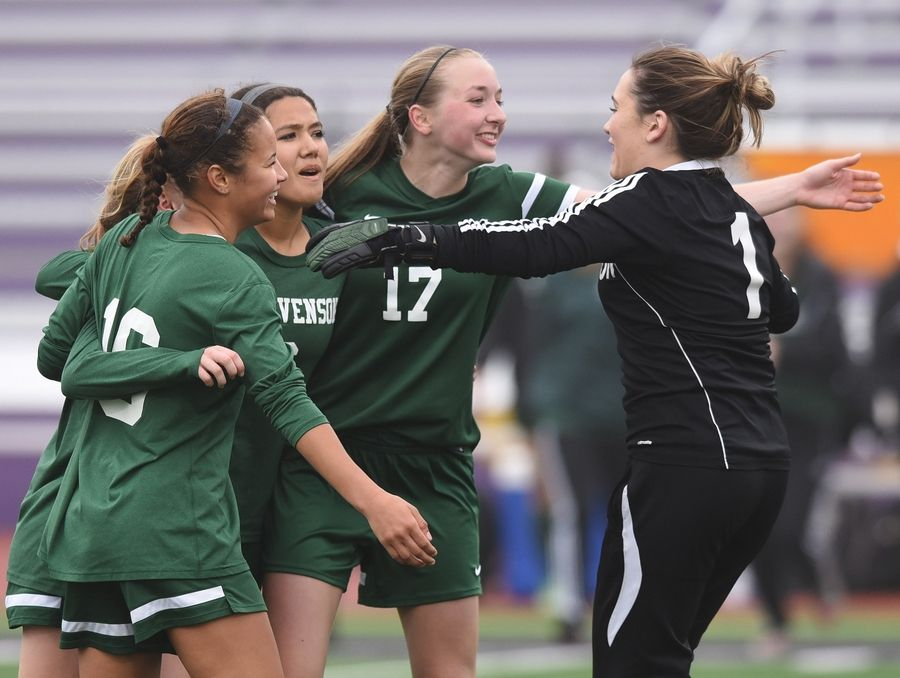Left to right, Stevenson's Brianna Van Zanten, Mackenzie Connington, Lauren Micek and Hannah Petrich celebrate their victory over the host Bulldogs during the North Suburban Conference championship game at Wauconda on Tuesday.