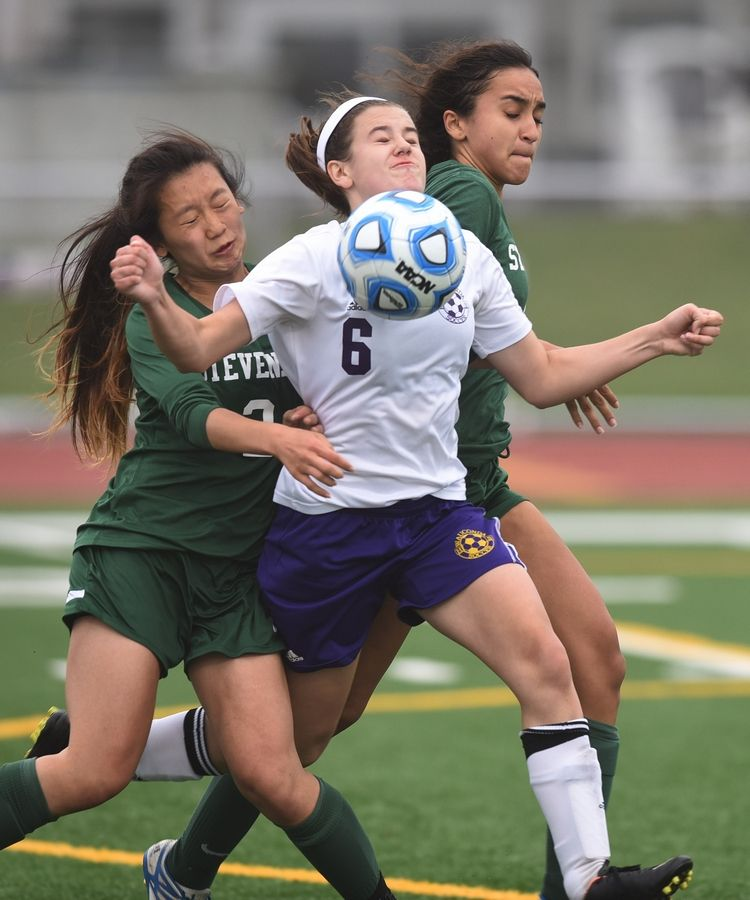 Stevenson's Maddy Ding, left, and Daniella Adjunta closely defend against a last-second move to the goal by Wauconda's Olivia Kuch during the North Suburban Conference championship game at Wauconda on Tuesday.