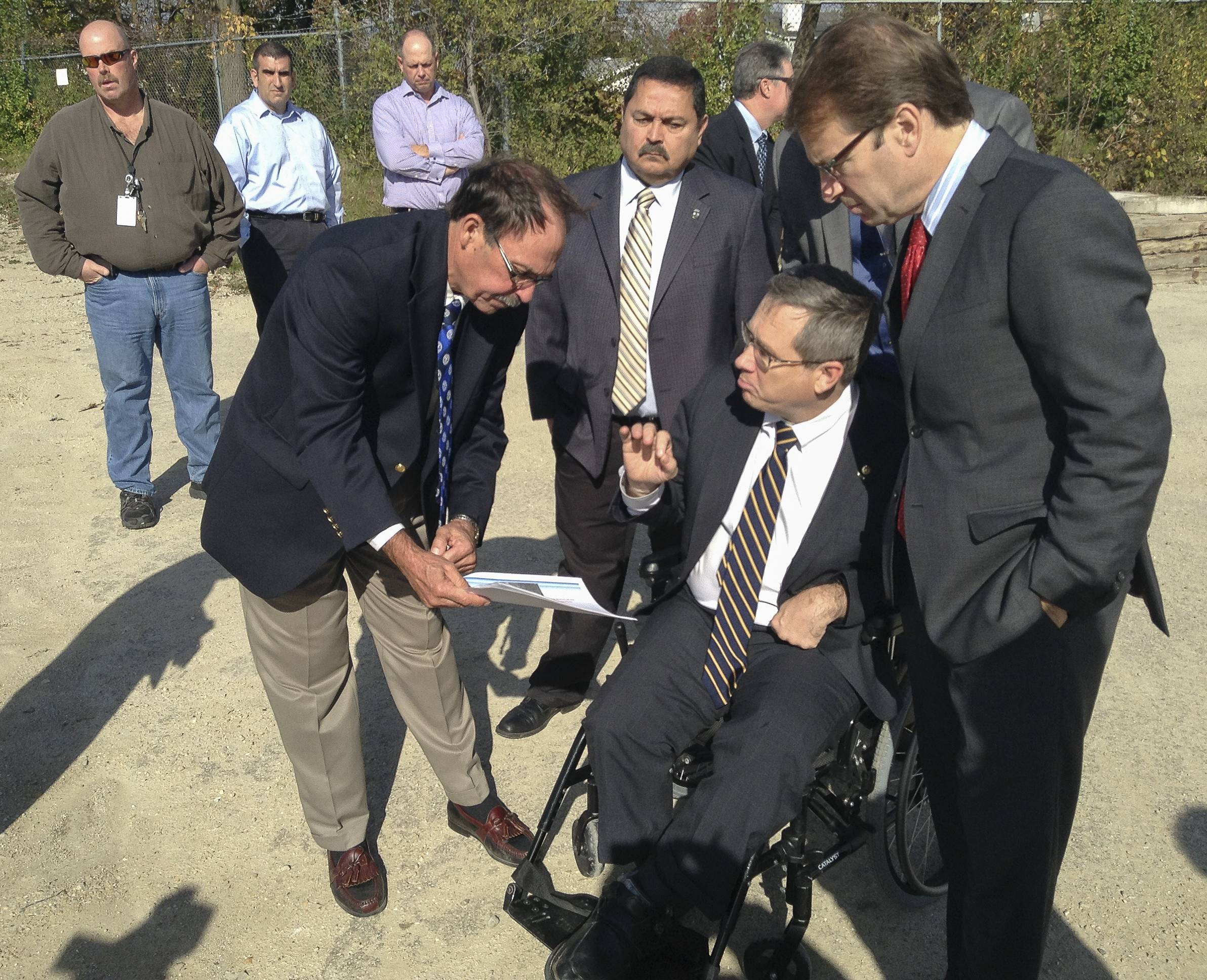 In October 2014, U.S. Rep. Peter Roskam, right, and U.S. Sen. Mark Kirk toured the former Kerr-McGee factory site in West Chicago. Both lawmakers have since worked to secure federal money to help pay for the cleanup of the property.