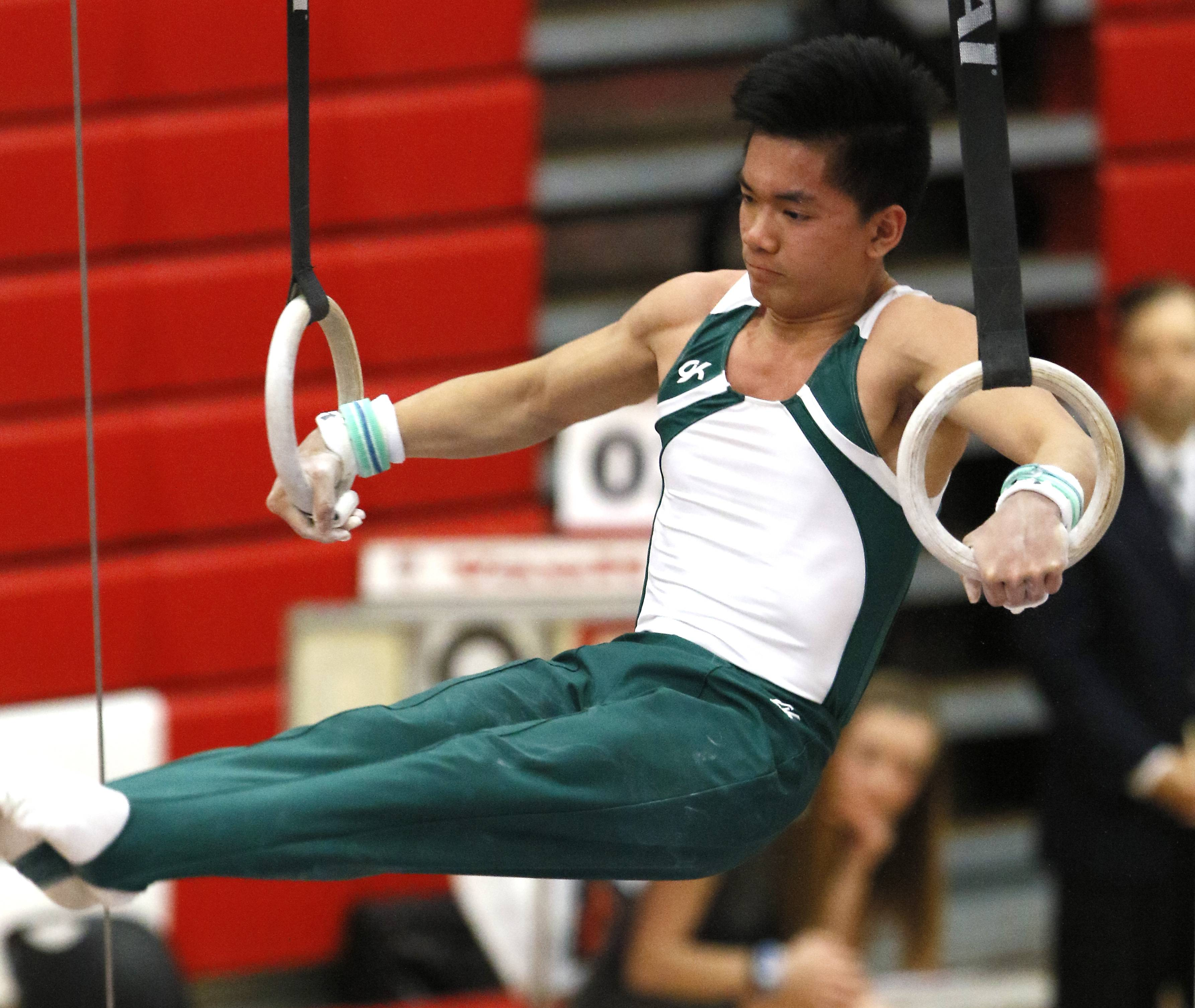 Glenbard West's Frankie Pham performs his still rings routine, Saturday, during the IHSA boys state gymnastics finals at Hinsdale Central High School.