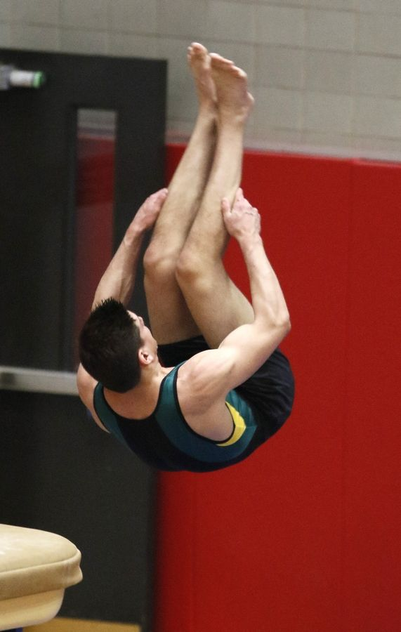Stevenson's Matt Krames performs his vault Saturday during the boys gymnastics state finals at Hinsdale Central.