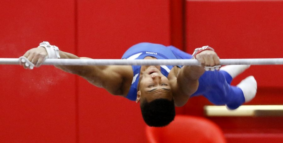Dundee Crown's Satchel Hudson performs his high bar routine Saturday during the boys gymnastics state finals at Hinsdale Central.