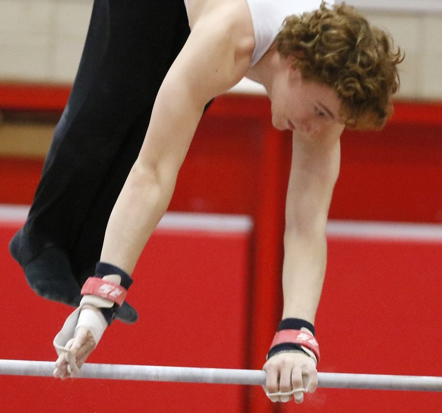 Fremd's Eric Barnd performs his high bar routine Saturday during the boys gymnastics state finals at Hinsdale Central.