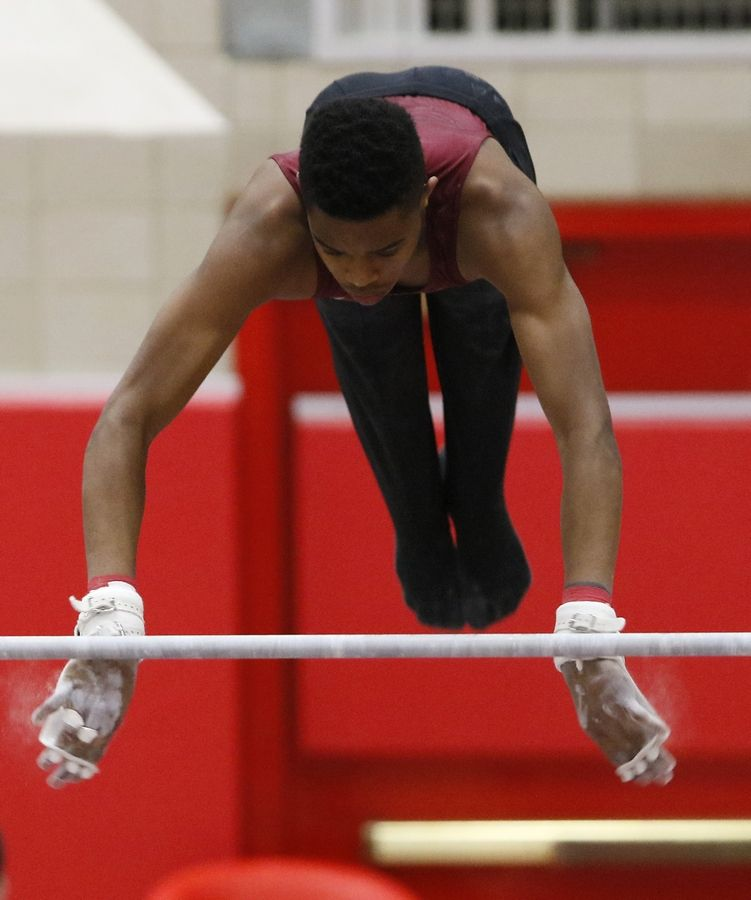 Schaumburg's Anthony Hardin performs his high bar routine Saturday during the boys gymnastics state finals at Hinsdale Central.