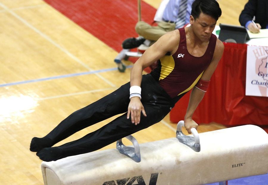 Schaumburg's Chasen Chau performs his pommel horse routine, Saturday, during the IHSA boys state gymnastics finals at Hinsdale Central High School.Daniel White/dwhite@dailyherald.comDundee-Crown's Satchel Hudson performs his floor exercise routine, Saturday, during the IHSA boys state gymnastics finals at Hinsdale Central High School.