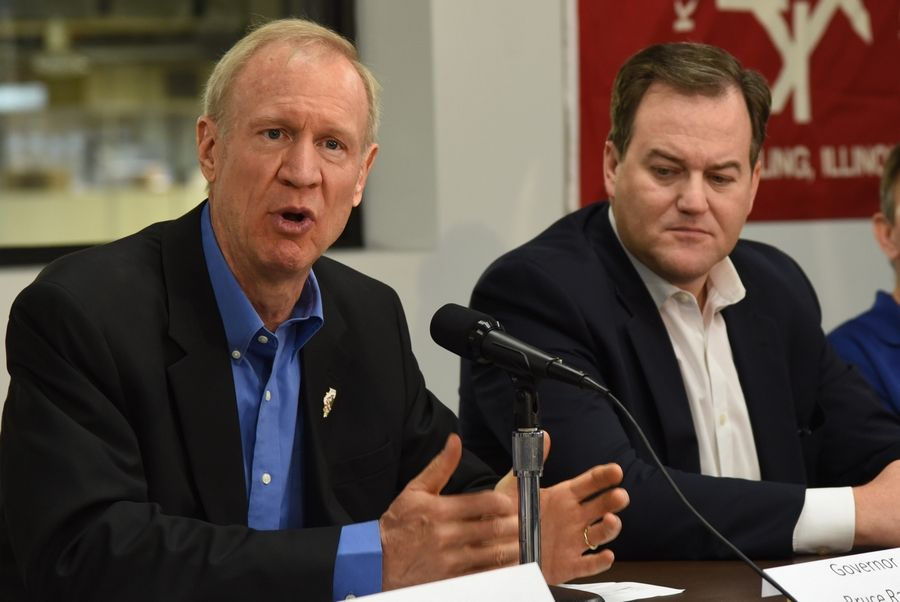 Gov. Bruce Rauner, left, and state Sen. Matt Murphy participate in a roundtable discussion Monday morning about reforms for job creation and lowering taxes at Keats Manufacturing in Wheeling.