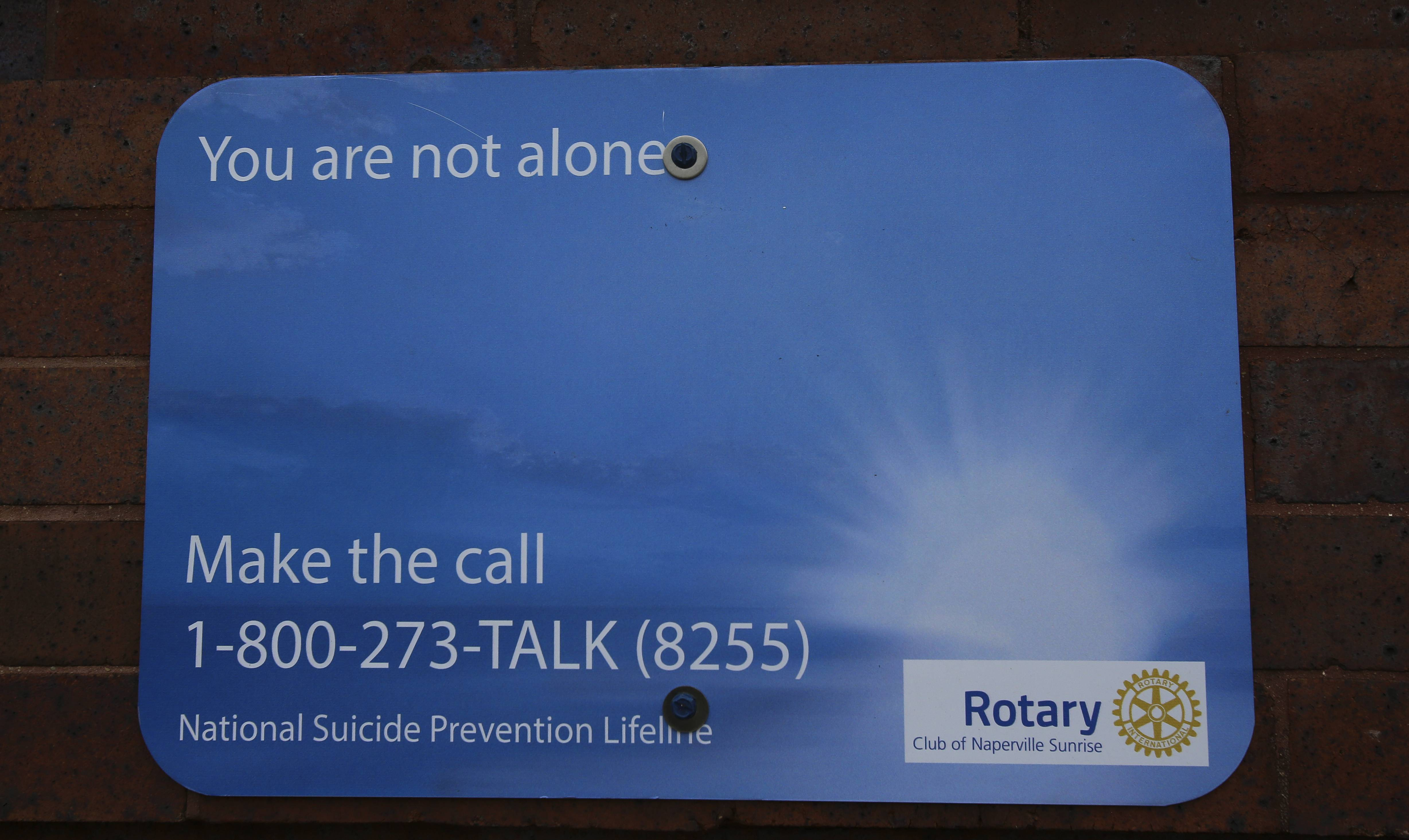 The Rotary Club of Naperville Sunrise sponsored these signs now posted at the 5th Avenue Metra station as a way to encourage people struggling with suicidal thoughts to seek help.